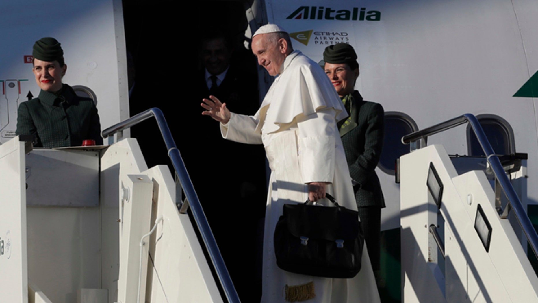 Pope Francis boards an airplane at Rome's Fiumicino international airport, on his way to Malmo, Sweden, Monday, Oct. 31, 2016. Pope Francis is heading to secular Sweden to mark the 500th anniversary of the Protestant Reformation. (AP Photo/Alessandra Tarantino)