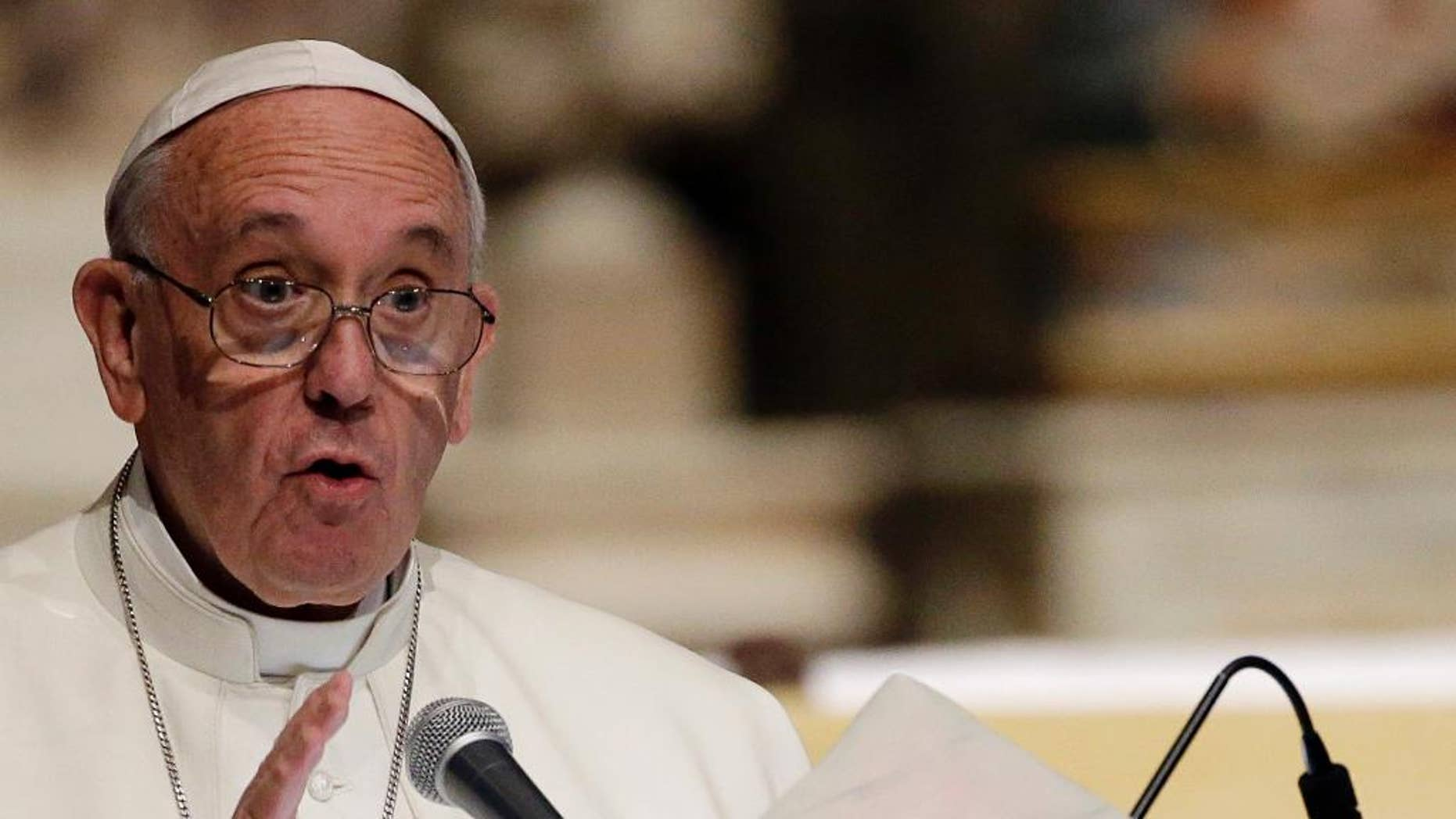 File photo - Pope Francis delivers his message in the Cathedral Santa Maria del Fiore during his visit to Florence, Italy, Tuesday, Nov. 10, 2015. (AP Photo/Gregorio Borgia) (The Associated Press)