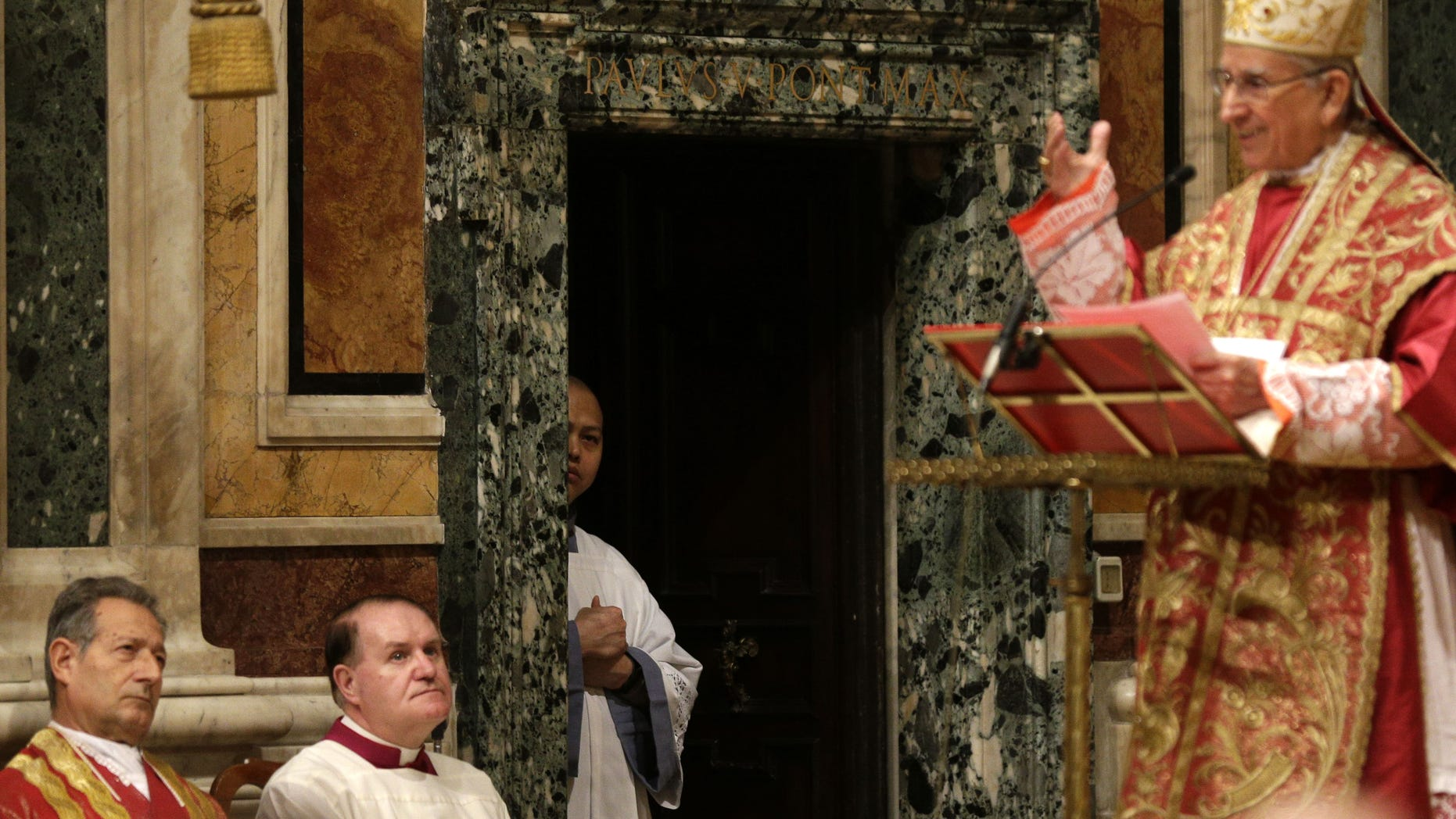 Prelates follow a mass for the election of the new pope celebrated by Cardinal Dario Castrillon Hoyos, right, inside St. Mary Major Basilica, in Rome, Friday, March 8, 2013. Cardinals have set Tuesday as the start date for the conclave to elect the next pope, signaling that they were wrapping up a week of discussions about the problems of the church and who best among them might lead it. (AP Photo/Alessandra Tarantino)