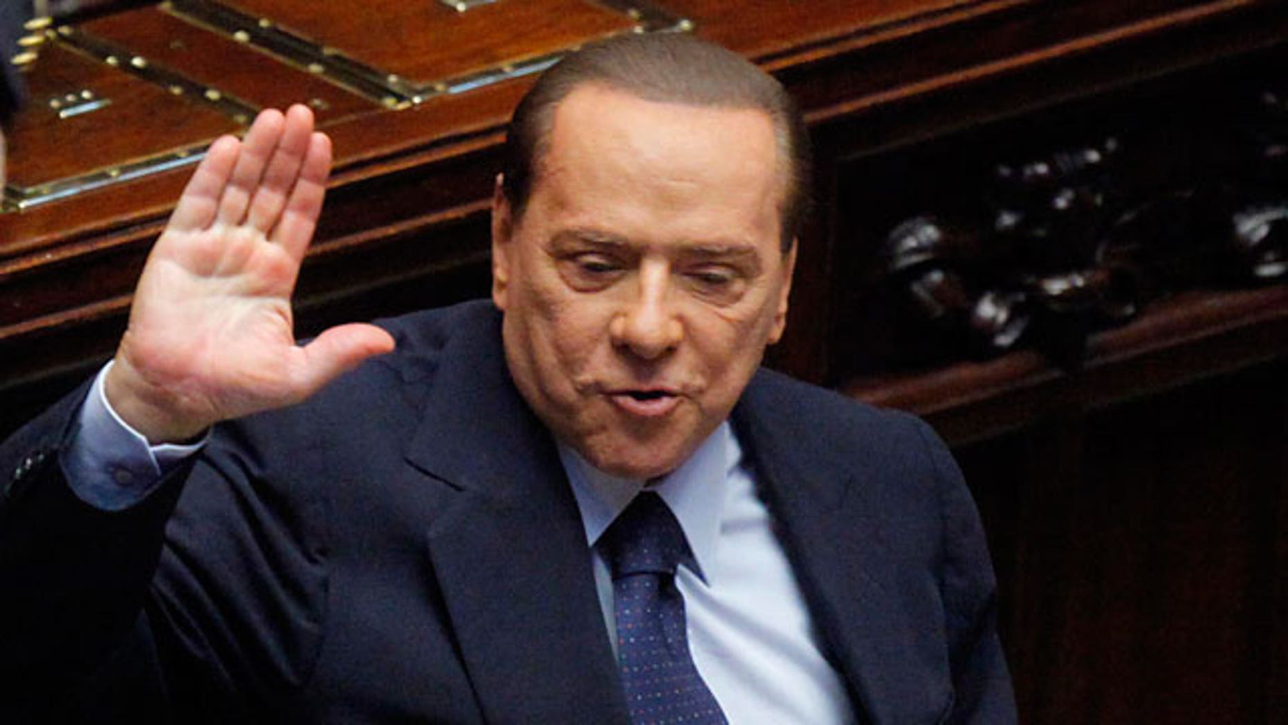 Italian Premier Silvio Berlusconi gestures in the Lower Chamber, in Rome, Friday, Oct. 14, 2011.
