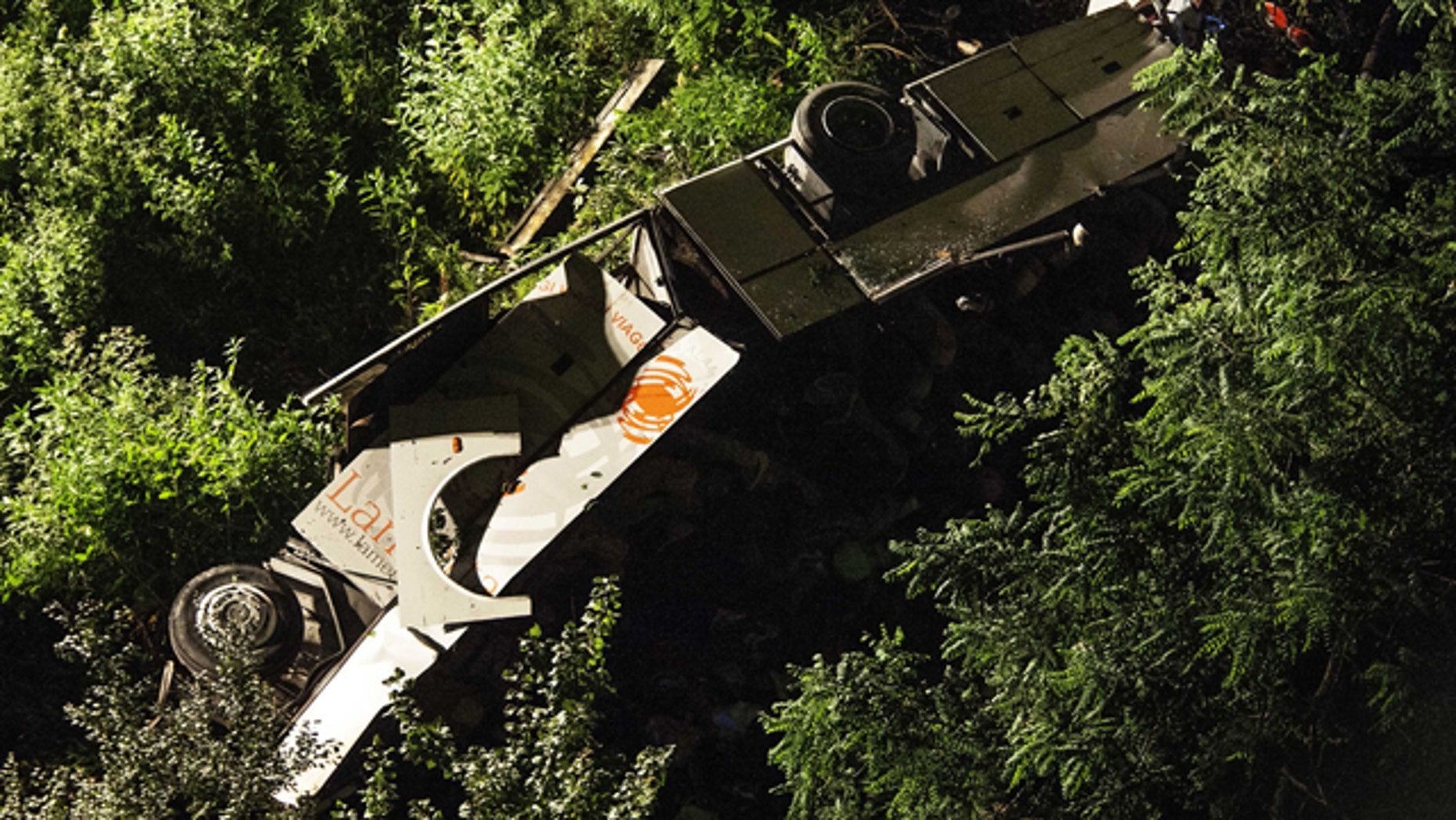 June 29, 2013: A bus lies on its side after plunging off a highway near Avellino, southern Italy.