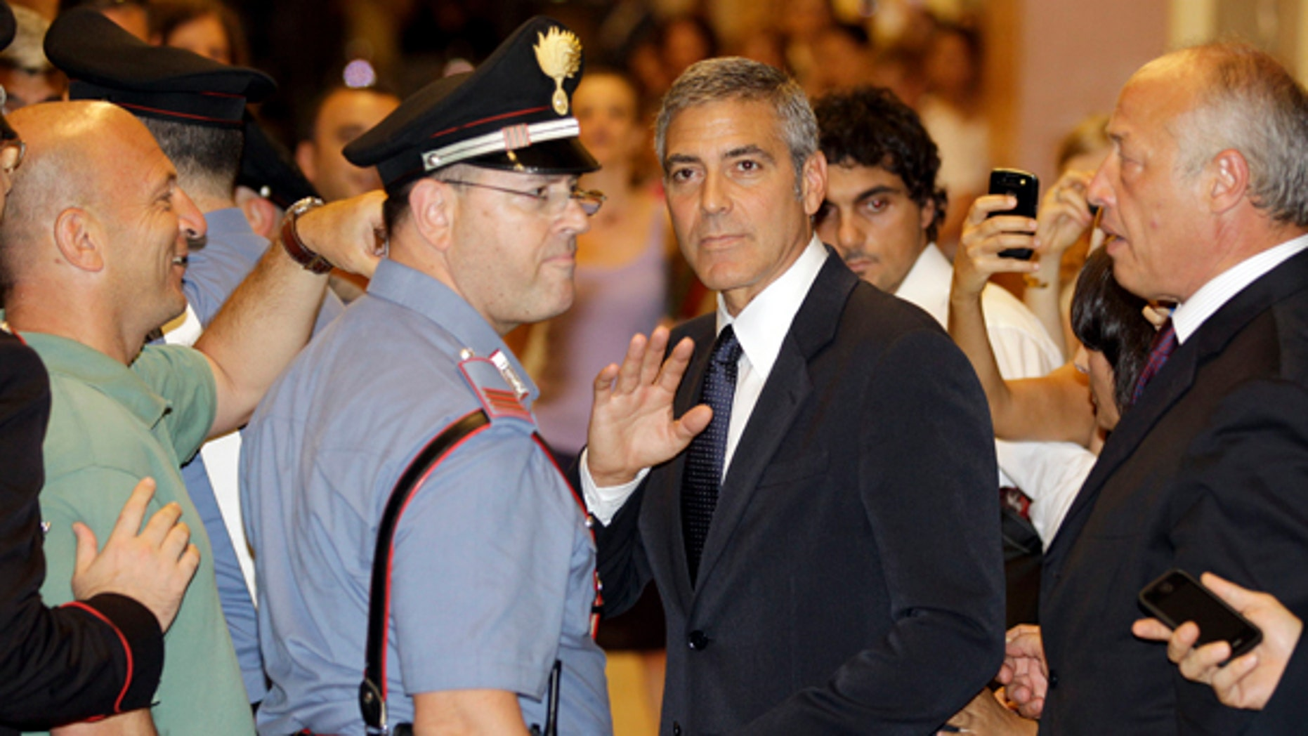 July 16: U.S. actor George Clooney leaves a tribunal in Milan, Italy.  Clooney appeared in court as a witness in a fraud trial against defendants charged with co opting his name for a line of clothing. (AP)