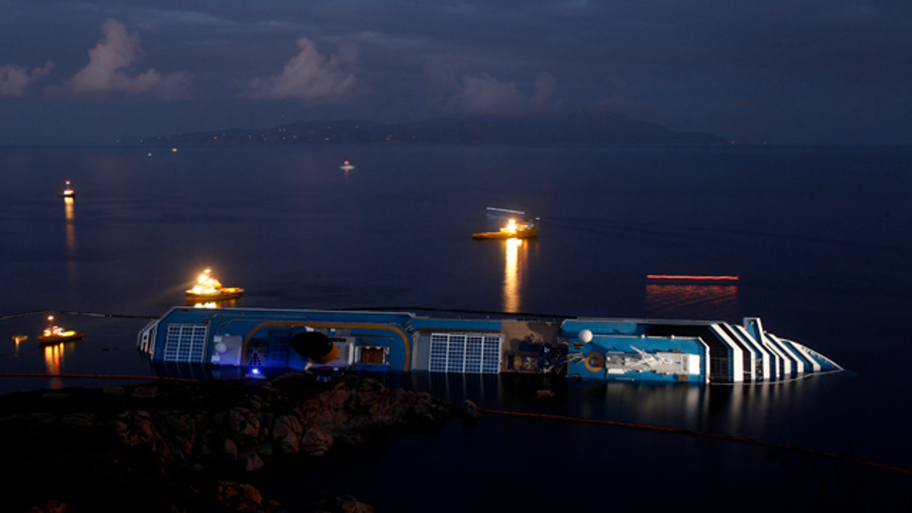 Jan. 23: The grounded cruise ship Costa Concordia lies on its side off the Tuscan island of Giglio, Italy.