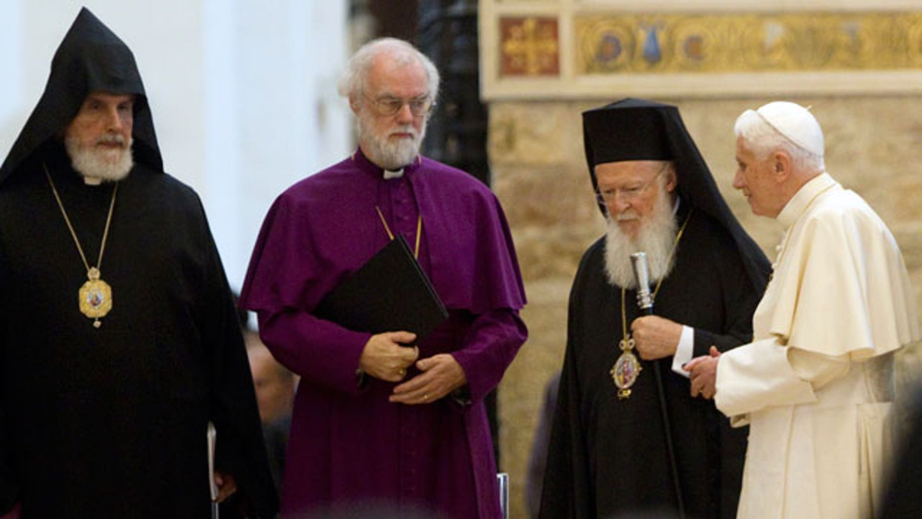 Oct. 27, 2011: From left, First Primate of the New Armenian Diocese of France Norvan Zakarian, Archbishop of Canterbury Rowan Douglas Williams, Ecumenical Patriarch Bartholomew I, and Pope Benedict XVI leave at the end of a peace meeting in the St. Mary of the Angels Basilica, in Santa Maria degli Angeli, central Italy.