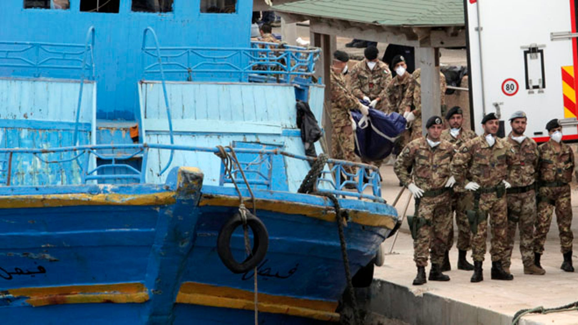 Oct. 6: Italian soldiers carry body bags at the Lampedusa island, Italy.