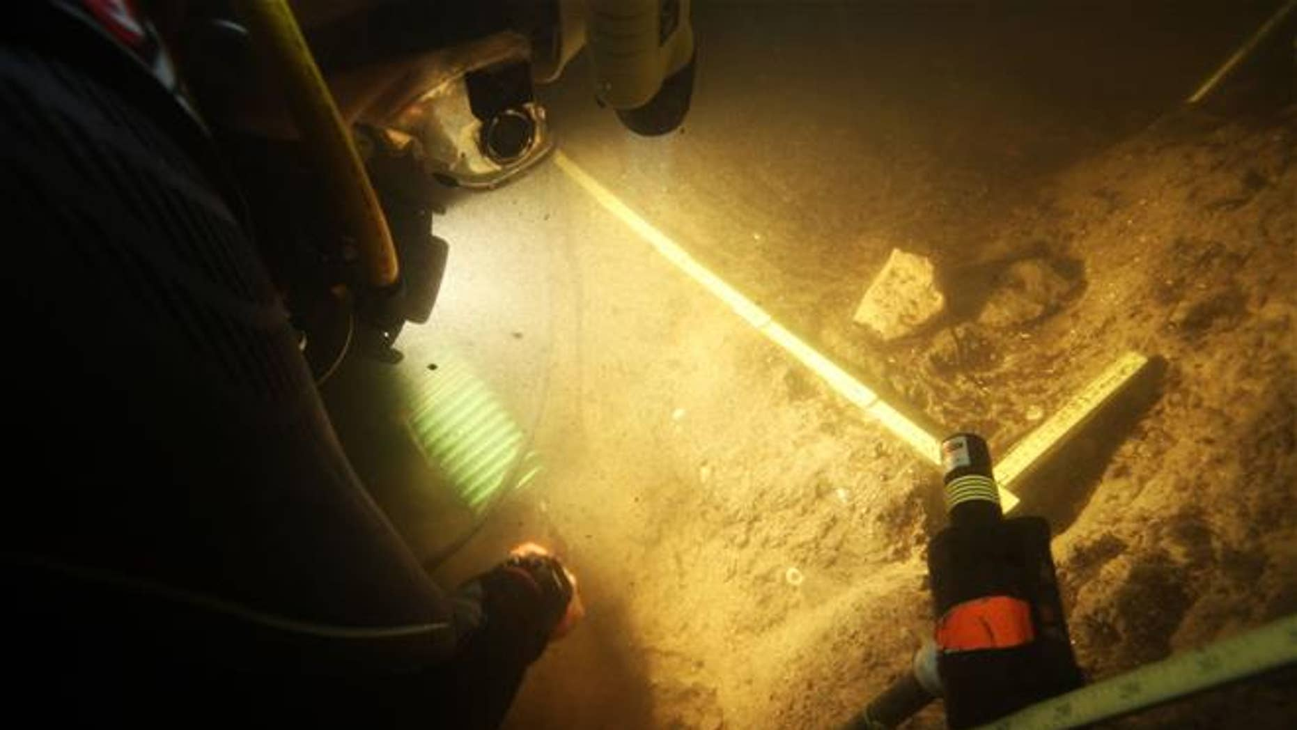 In this 2015 photo provided by Texas A&M's Center for the Study of the First Americans, divers investigate the Page-Ladson archaeological site in Florida.