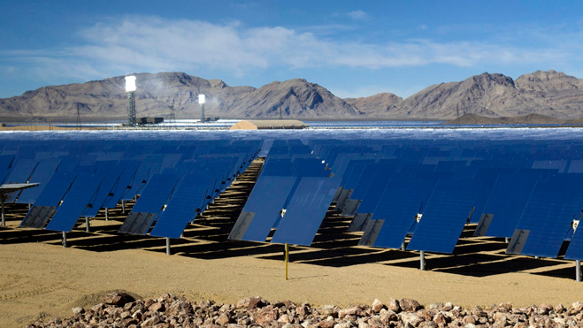 In this Feb. 13, 2014 file photo, mirrors are shown during a tour of the Ivanpah Solar Electric Generating System in the Mojave Desert near the California-Nevada border.
