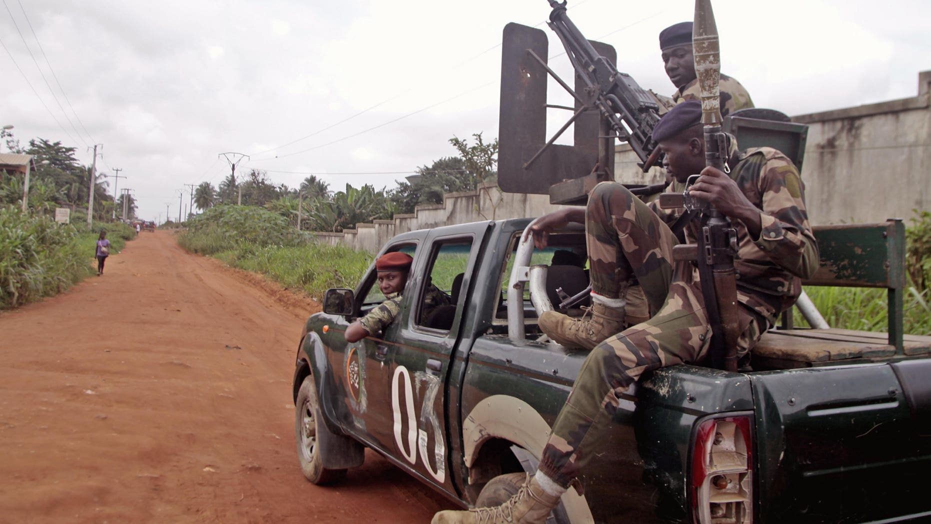 Aug. 6, 2012: Ivory Coast troops patrol around the Cocody area in the city of Abidjan, Ivory Coast. An Ivory Coast military official says seven soldiers have been killed in another attack by gunmen on a military camp in the commercial capital, Abidjan.