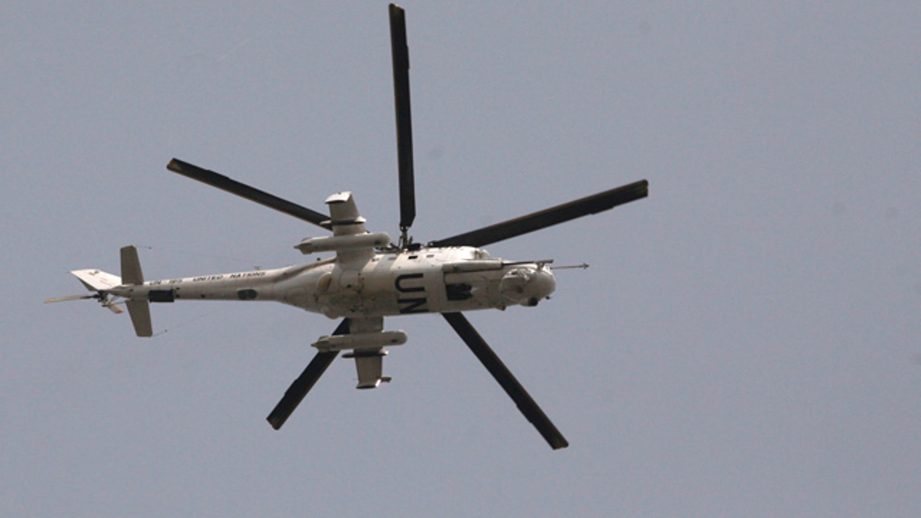 April 1, 2011: A UN helicopter passes over the city of  Abidjan, Ivory Coast.