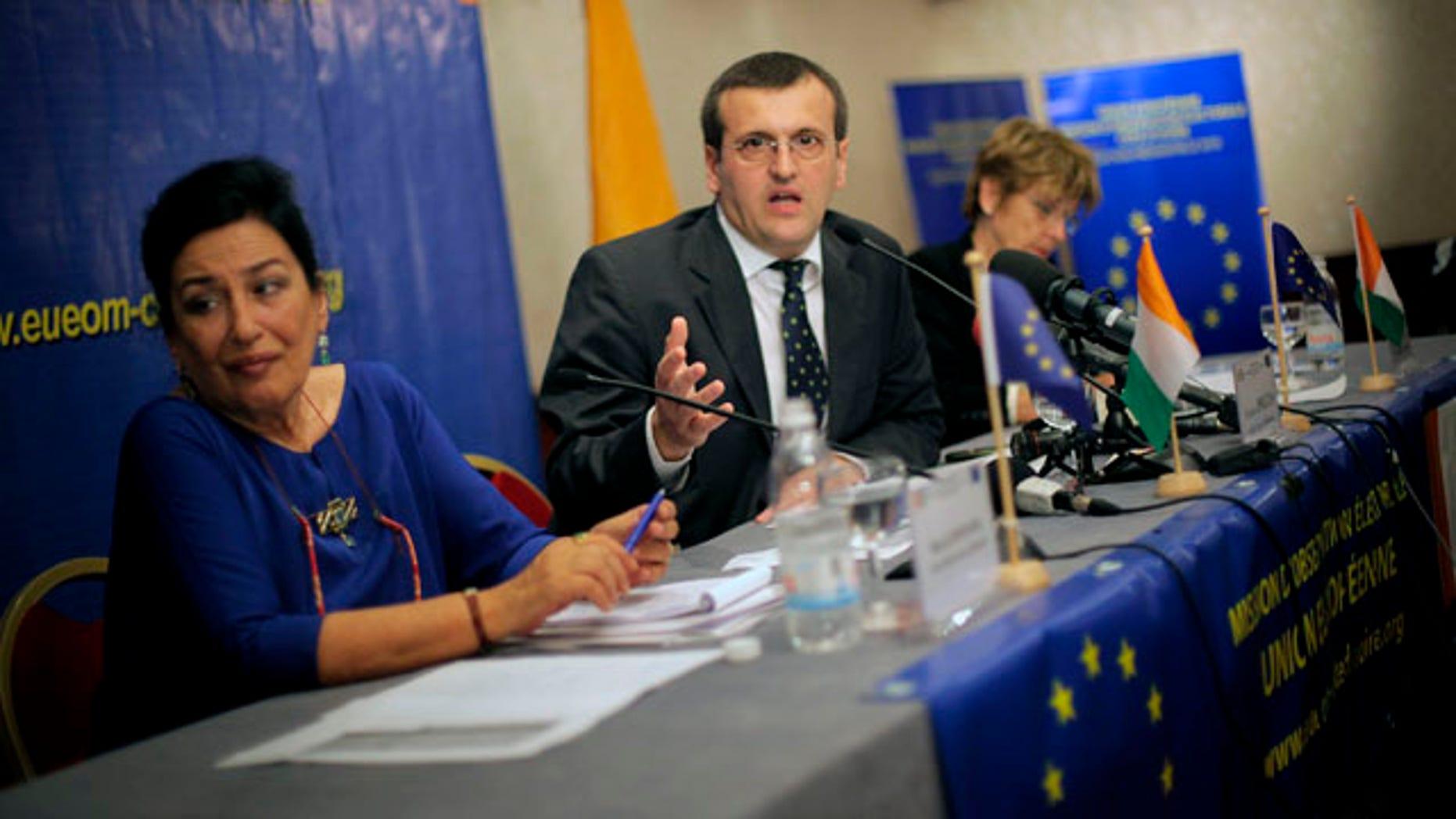Nov. 2: European Union Chief Elections Observer Cristian Preda, center, from Romania, addresses a news conference in Abidjan, Ivory Coast.