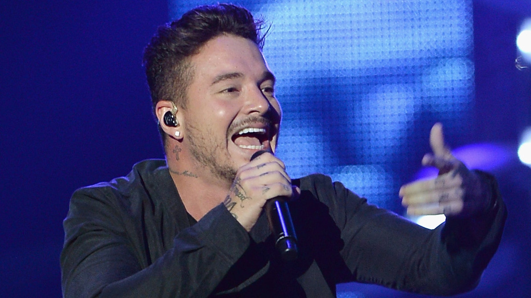 "MIAMI, FL - AUGUST 20:  J Balvin performs onstage at Telemundo's ""Premios Tu Mundo"" Awards 2015 at American Airlines Arena on August 20, 2015 in Miami, Florida.  (Photo by Rodrigo Varela/Getty Images)"