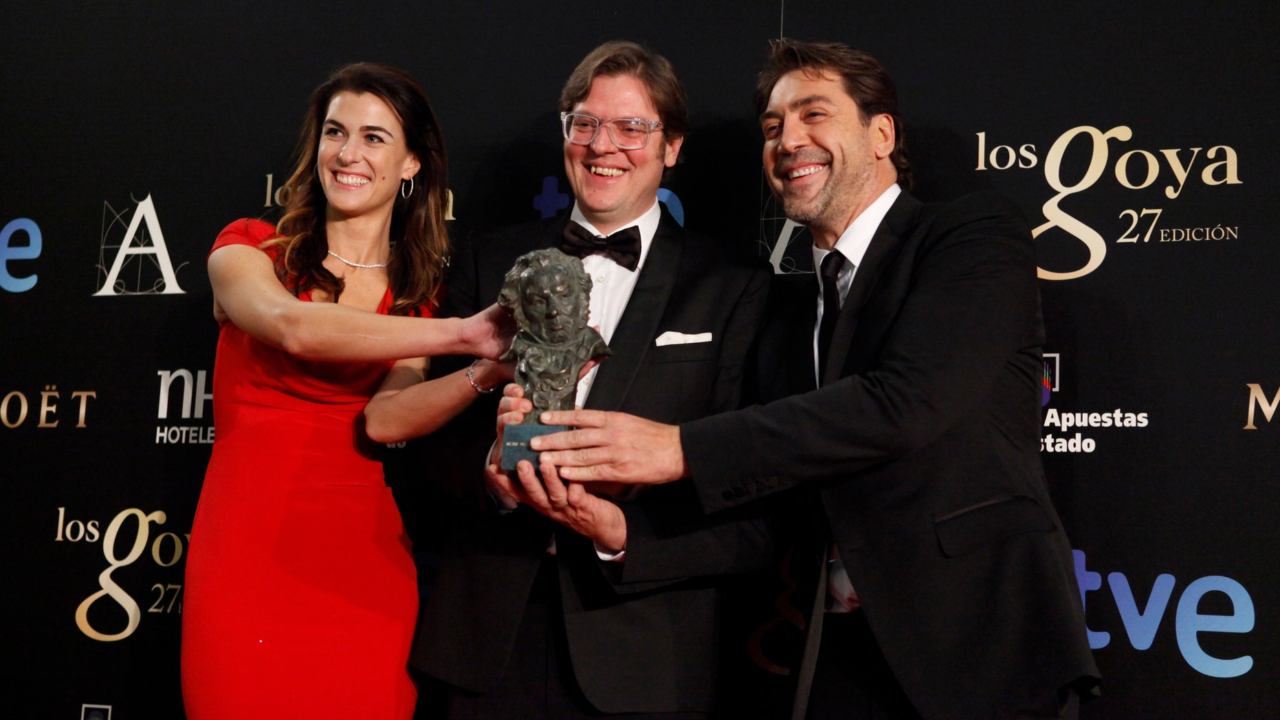 "Lilly Hartley, Alvaro Longoria and Javier Bardem hold the award for Best Documentary Flim in the film ""Hijos de las Nubes, La Ultima Colonia"" during the 2013 edition of the Goya Cinema Awards ceremony at Centro de Congresos Principe Felipe  in Madrid, Spain."