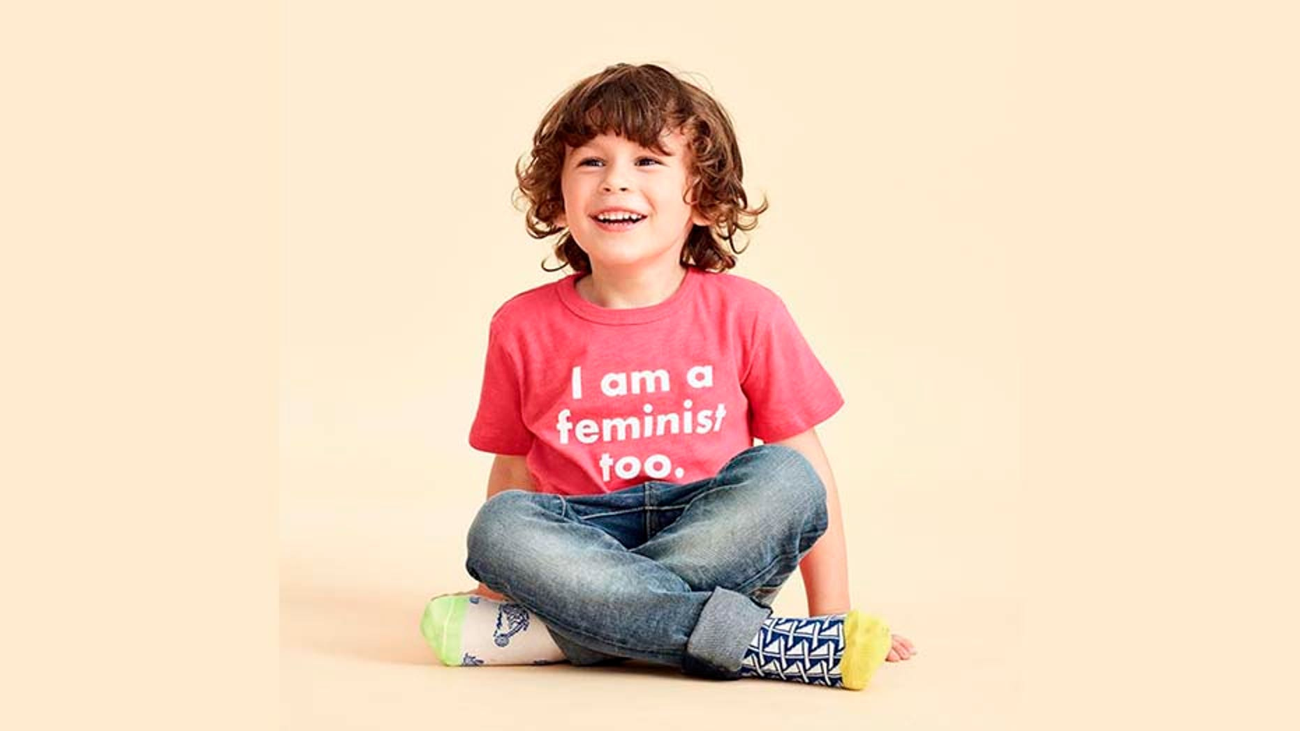 J.Crew posted a photo on Friday that featured a young male model in the controversial pink, feminist-focused T-shirt.
