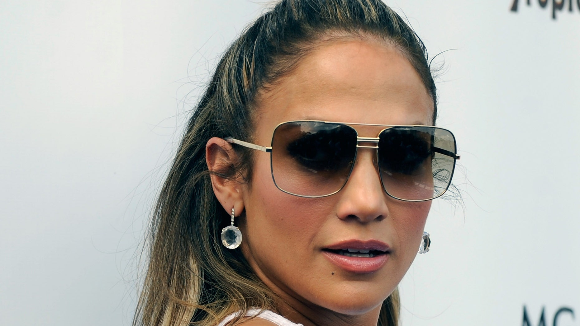 LAS VEGAS, NV - AUGUST 18:  Singer/actress Jennifer Lopez arrives for an appearance at the Wet Republic pool at the MGM Grand Hotel/Casino on August 18, 2012 in Las Vegas, Nevada.  (Photo by David Becker/Getty Images)