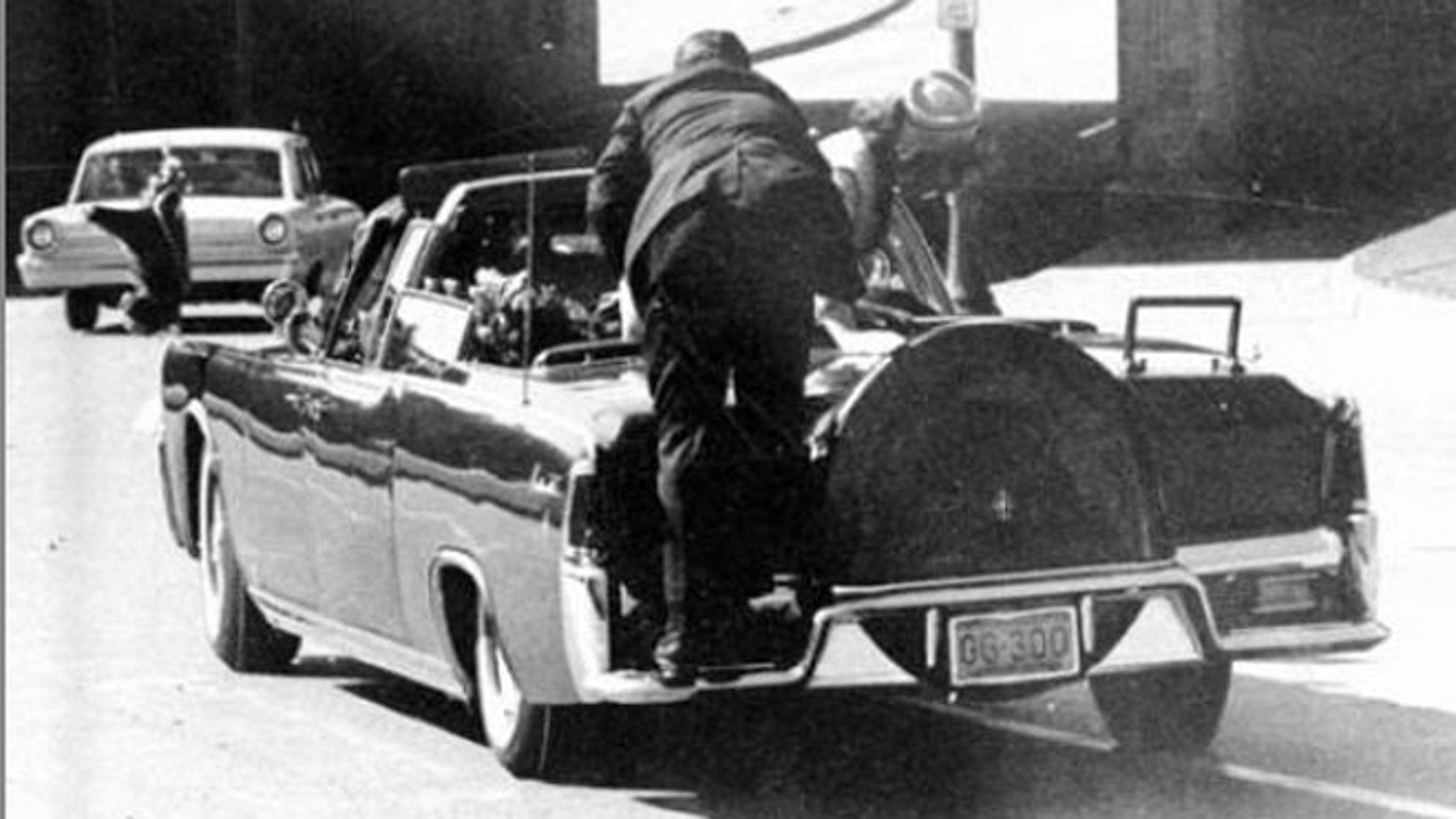 Nov. 22, 1963: President John F. Kennedy is slumped in the backseat of this car immediately after being shot in Dallas.
