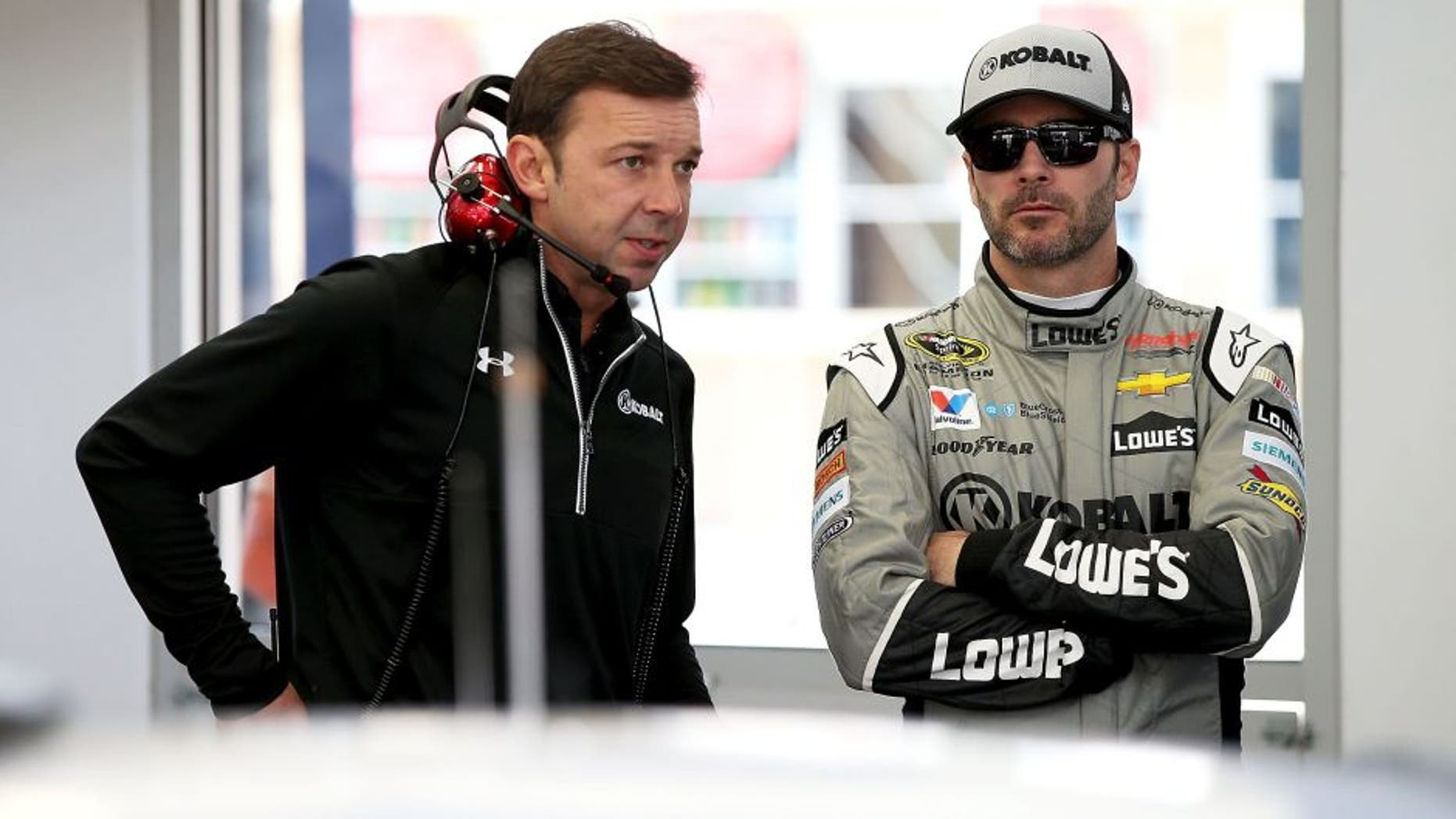 LAS VEGAS, NV - MARCH 03: (L-R) Crew Chief Chad Knous talks with Jimmie Johnson, driver of the #48 Kobalt Chevrolet, in the garage during Testing at Las Vegas Motor Speedway on March 3, 2016 in Las Vegas, Nevada. (Photo by Sean Gardner/NASCAR via Getty Images)