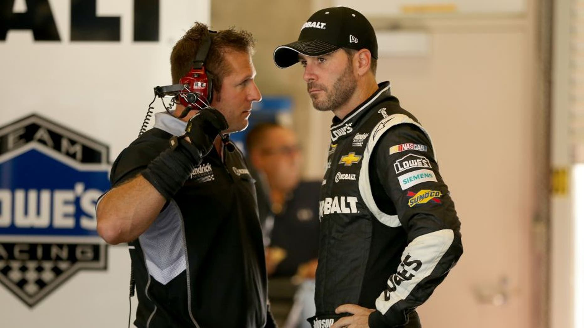 INDIANAPOLIS, IN - JULY 24: Jimmie Johnson, driver of the #48 Kobalt Tools Chevrolet, stands in the garage during practice for the NASCAR Sprint Cup Series Crown Royal Presents the Jeff Kyle 400 at the Brickyard at Indianapolis Motorspeedway on July 24, 2015 in Indianapolis, Indiana. (Photo by Andy Lyons/Getty Images)