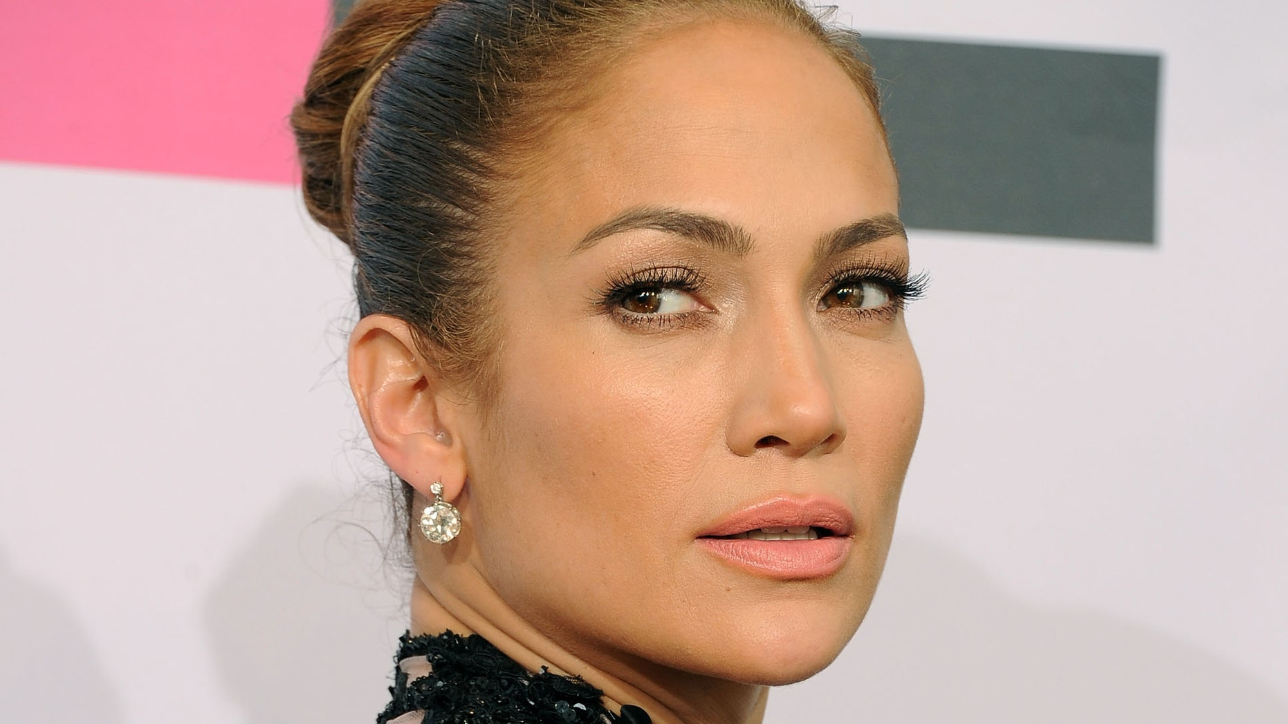 LOS ANGELES, CA - NOVEMBER 20:  Singer Jennifer Lopez, winner of Favorite Latin Artist Award, poses in the press room at the 2011 American Music Awards held at Nokia Theatre L.A. LIVE on November 20, 2011 in Los Angeles, California.  (Photo by Jason Merritt/Getty Images)