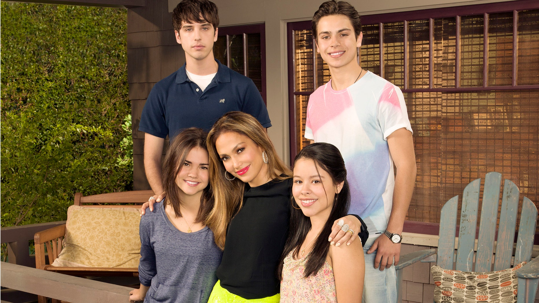 """This undated image released by ABC Family shows, from row from left, Maia Mitchell, executive producer Jennifer Lopez, Cierra Ramirez, from back left, David Lambert and Jake T. Austin from """"The Fosters""""."""