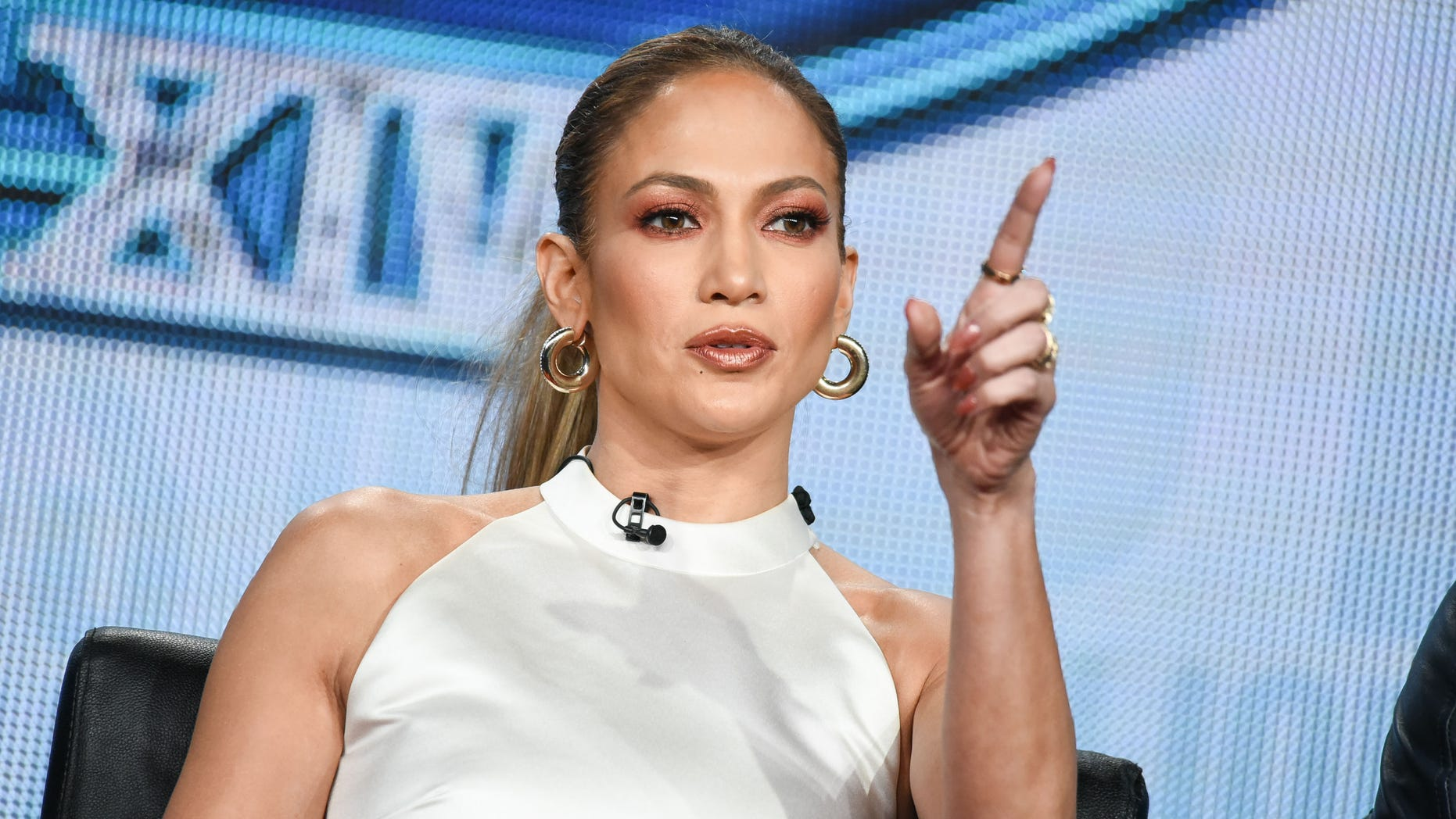 "Jennifer Lopez speaks on stage during the ""American Idol"" panel at the Fox 2015 Winter TCA on Saturday, Jan. 17, 2015, in Pasadena, Calif. (Photo by Richard Shotwell/Invision/AP)"