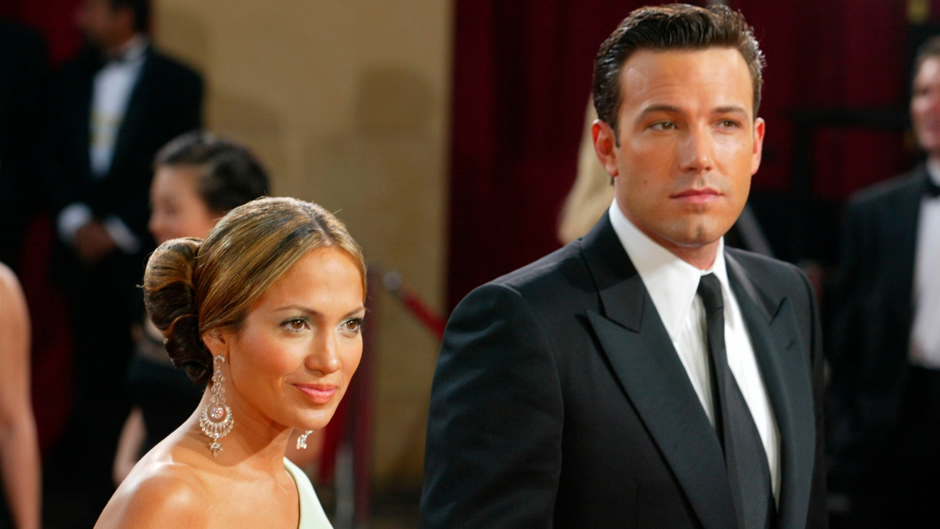 HOLLYWOOD - MARCH 23:  (FILE PHOTO) Actors Ben Affleck and fiancee Jennifer Lopez attend the 75th Annual Academy Awards at the Kodak Theater on March 23, 2003 in Hollywood, California.  Lopez and Affleck postponed their wedding, which was scheduled for this weekend, and has now reportedly spit up, possibly temporarily.  (Photo by Kevin Winter/Getty Images)