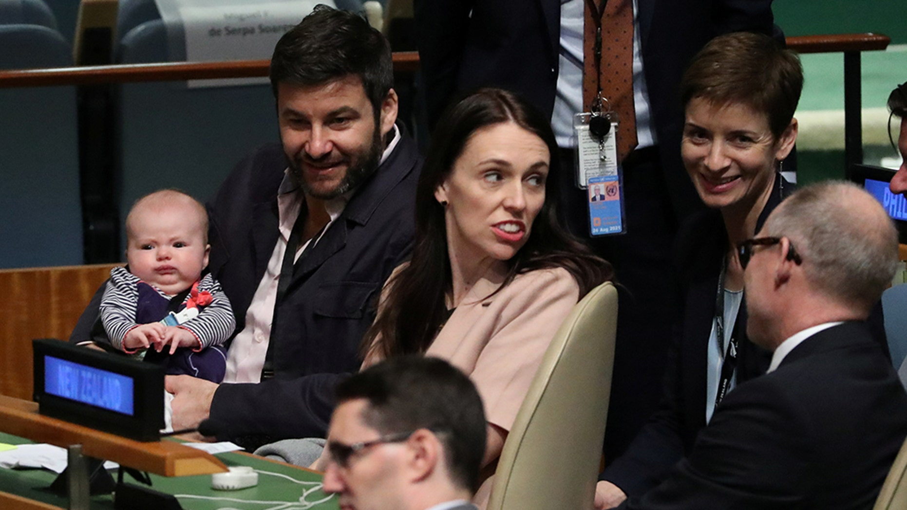 New Zealand Prime Minister Jacinda Ardern sits with her baby Neve before speaking at the Nelson Mandela Peace Summit during the 73rd United Nations General Assembly in New York, U.S., September 24, 2018. REUTERS/Carlo Allegri - RC1D451BD190