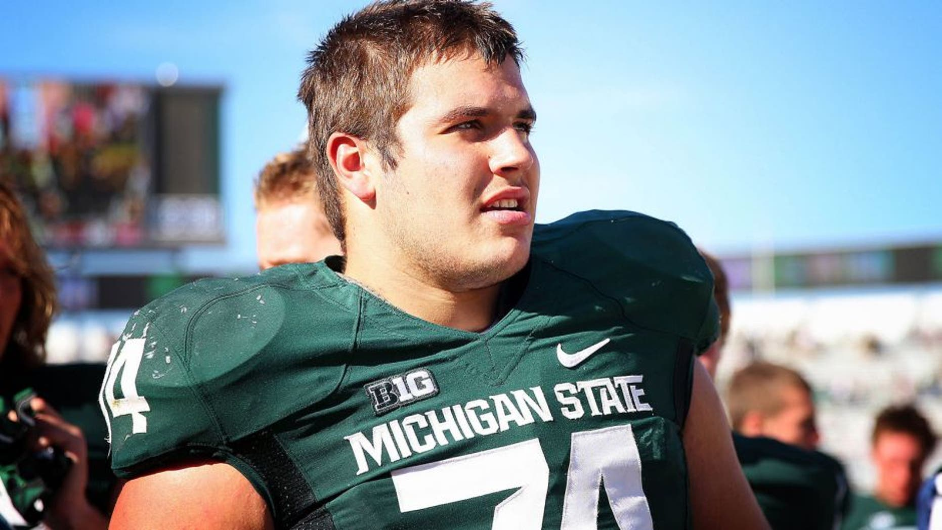 Oct 12, 2013; East Lansing, MI, USA; Michigan State Spartans offensive tackle Jack Conklin (74) celebrates the win after a game at Spartan Stadium. Mandatory Credit: Mike Carter-USA TODAY Sports