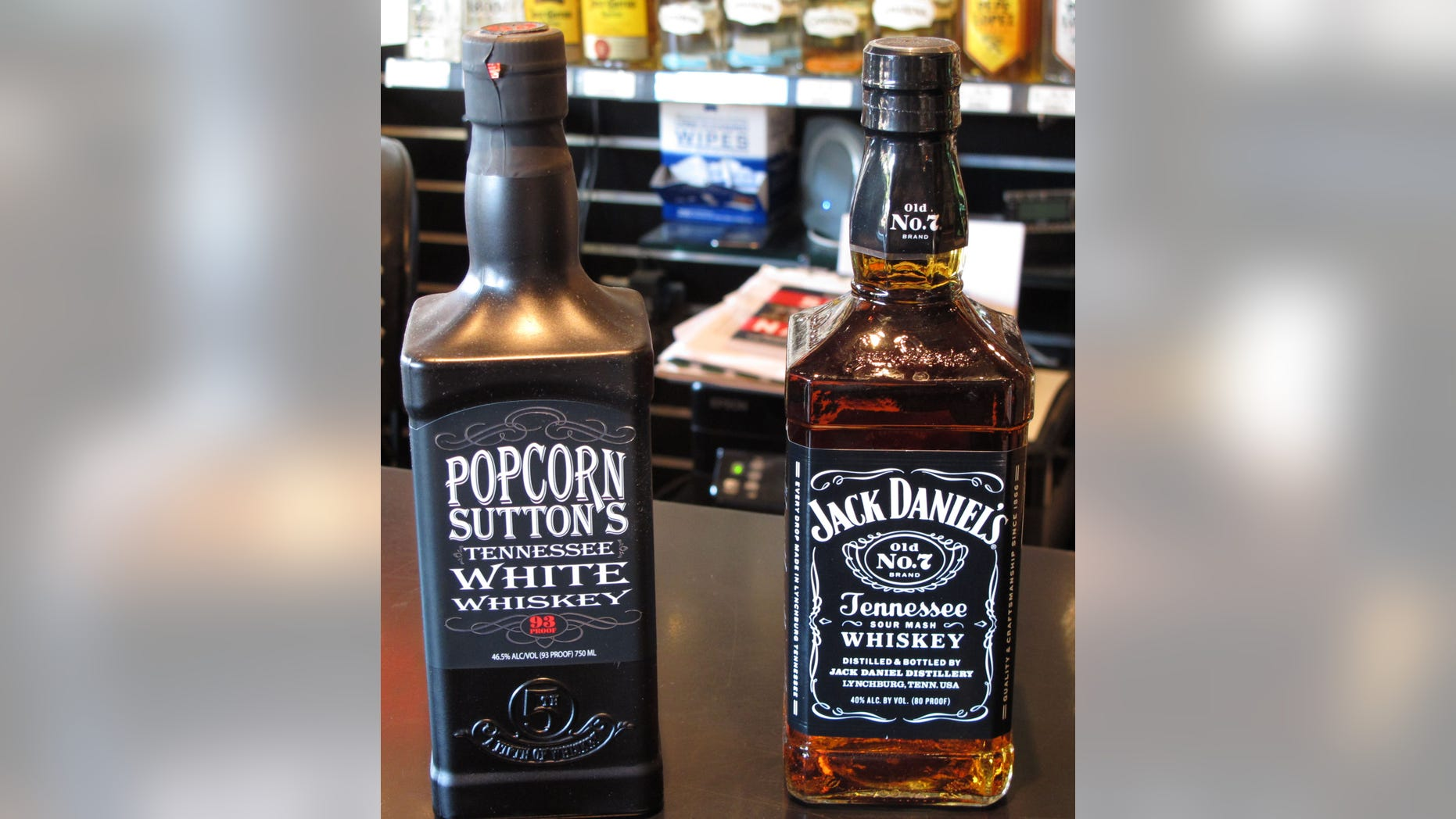 Bottles of Popcorn Suttons Tennessee White Whiskey and Jack Daniels Tennessee whiskey sit side by side at a Louisville, Ky., liquor store.