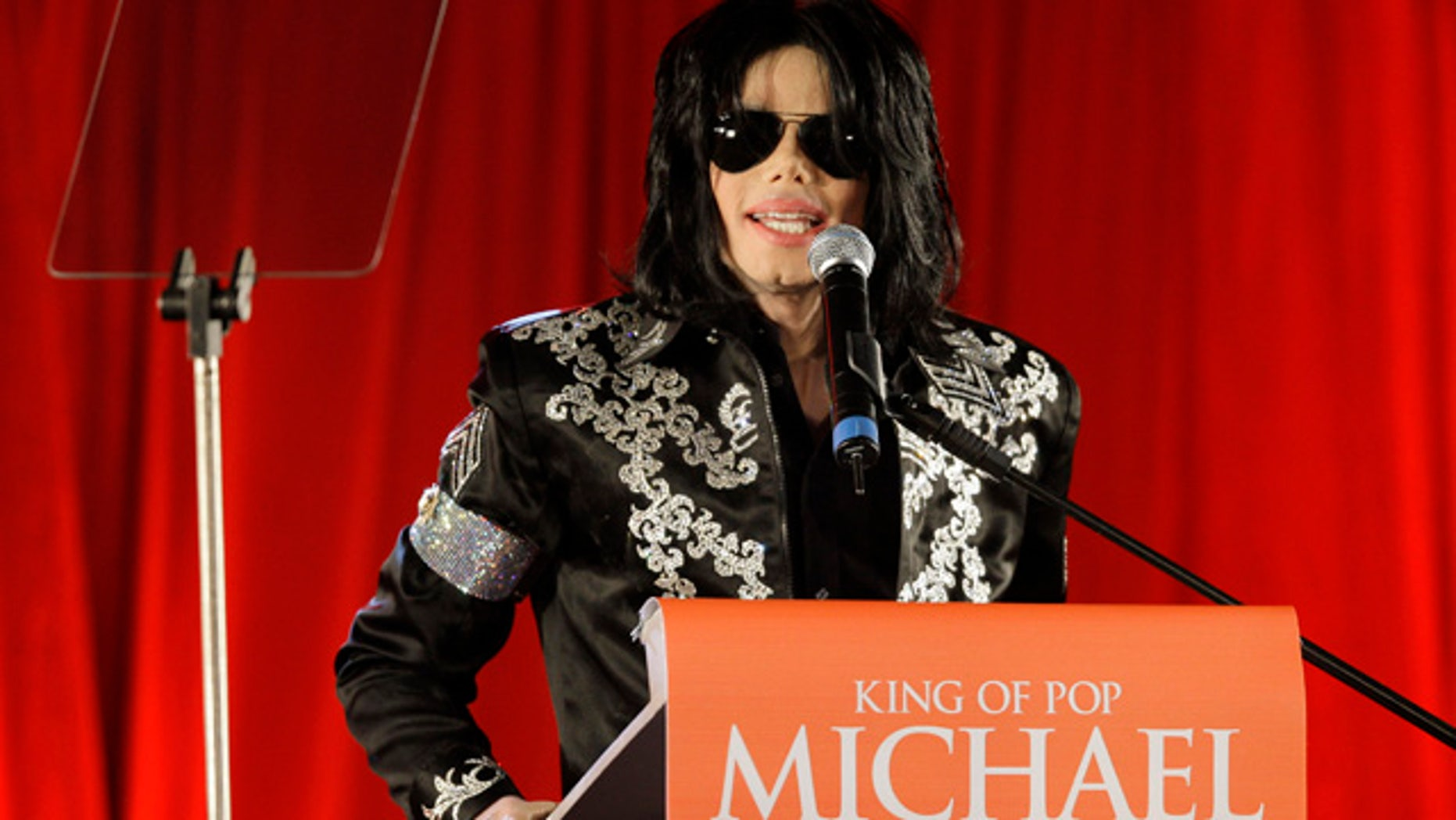 FILE - In this March 5, 2009 file photo, US singer Michael Jackson announces that he is set to play ten live concerts at London's O2 Arena in July (AP Photo/Joel Ryan, File)