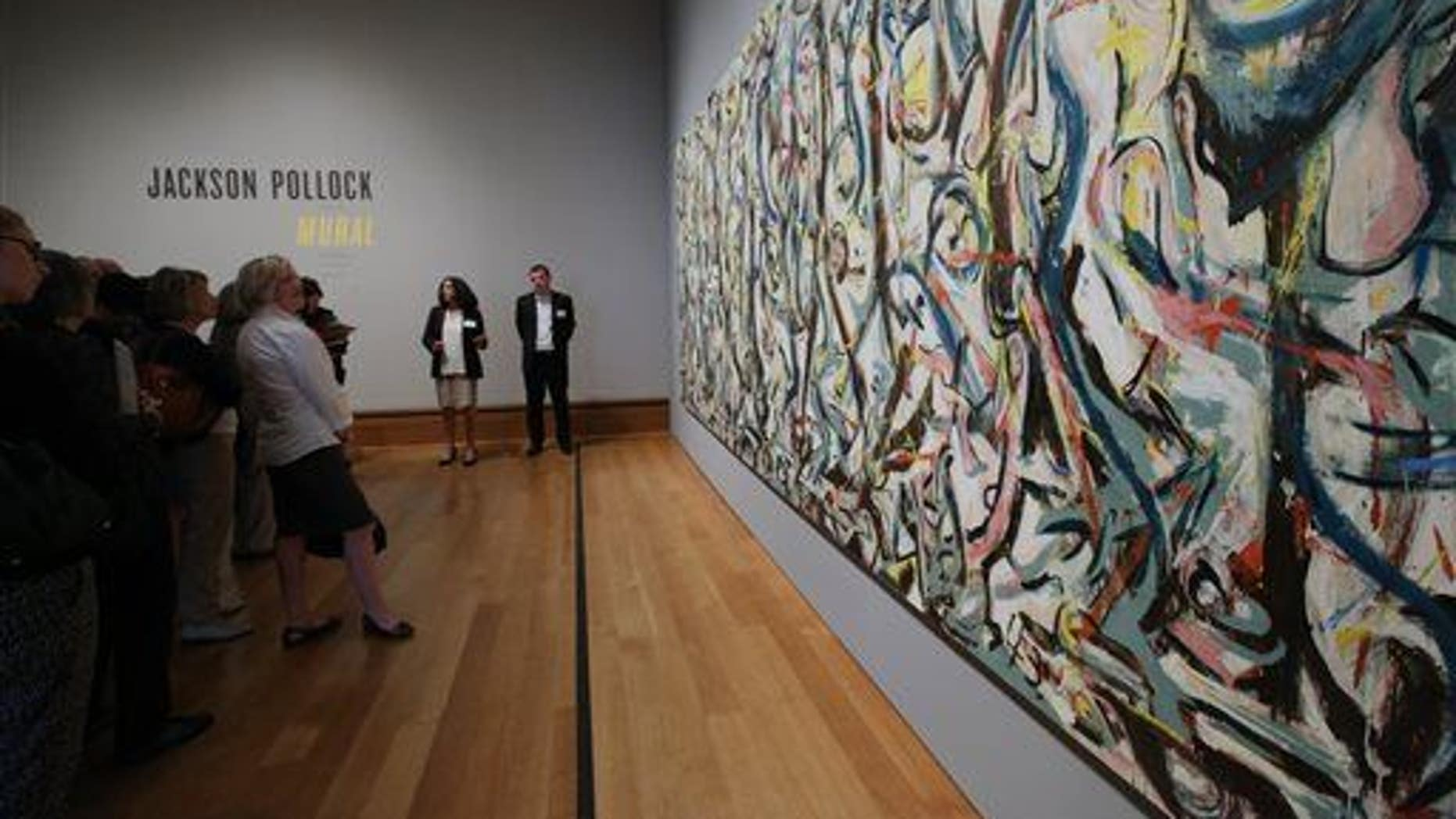 Members of the media preview Jackson Pollock's ���Mural,��� 1943, at the J. Paul Getty Museum in Los Angeles on Monday, March 10, 2014.
