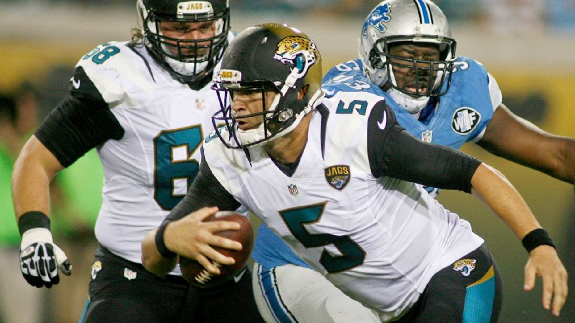 Aug 28, 2015; Jacksonville, FL, USA; Jacksonville Jaguars quarterback Blake Bortles (5) runs away from Detroit Lions defensive tackle Tyrunn Walker (93) in the first quarter of a preseason NFL football game at EverBank Field. Mandatory Credit: Phil Sears-USA TODAY Sports