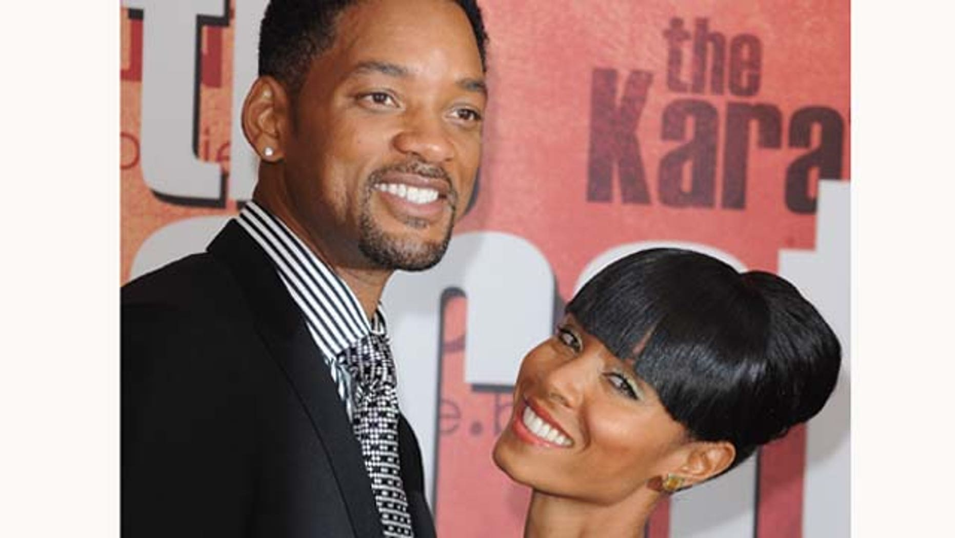 July 25, 2010: Actors Will Smith (L) and wife Jada Pinkett Smith (R) attend 'The Karate Kid' film premiere at Le Grand Rex in Paris, France.