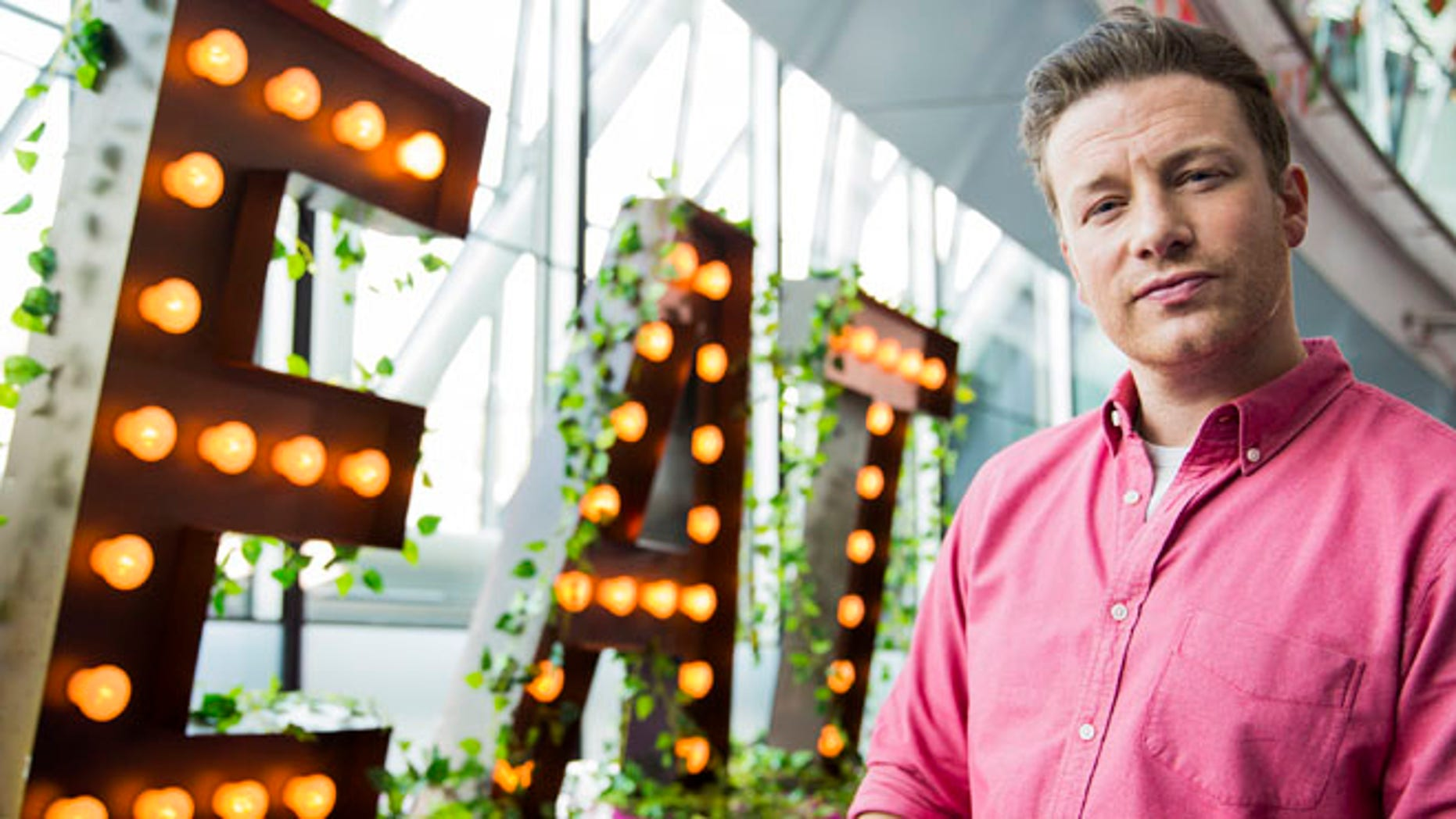 LONDON, ENGLAND - MAY 16:  Jamie Oliver broadcasts a live cooking class from City Hall  to school children across the globe as part of the third annual Food Revolution Day on May 16, 2014 in London, England.  (Photo by Tristan Fewings/Getty Images)