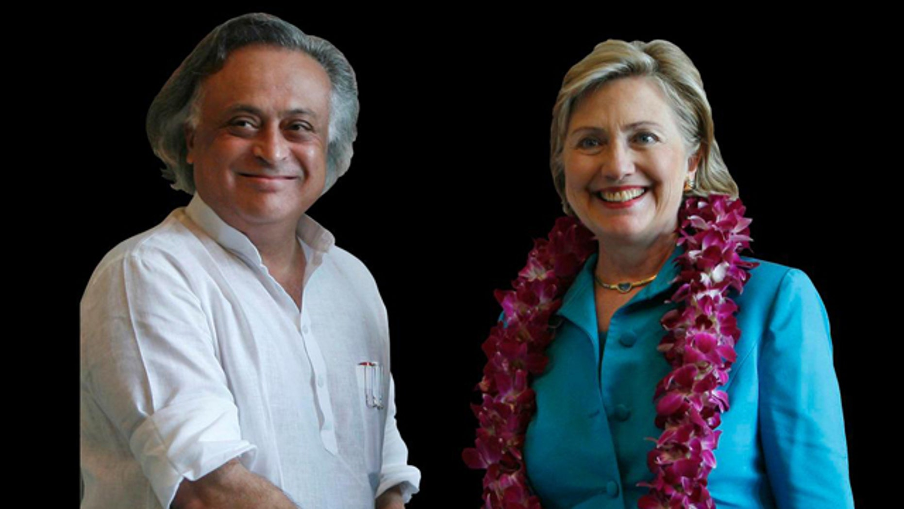 Jairam Ramesh, India's Junior Minister for Environment and Forests, and Hillary Rodham Clinton, US Secretary of State, shake hands in New Delhi, India.