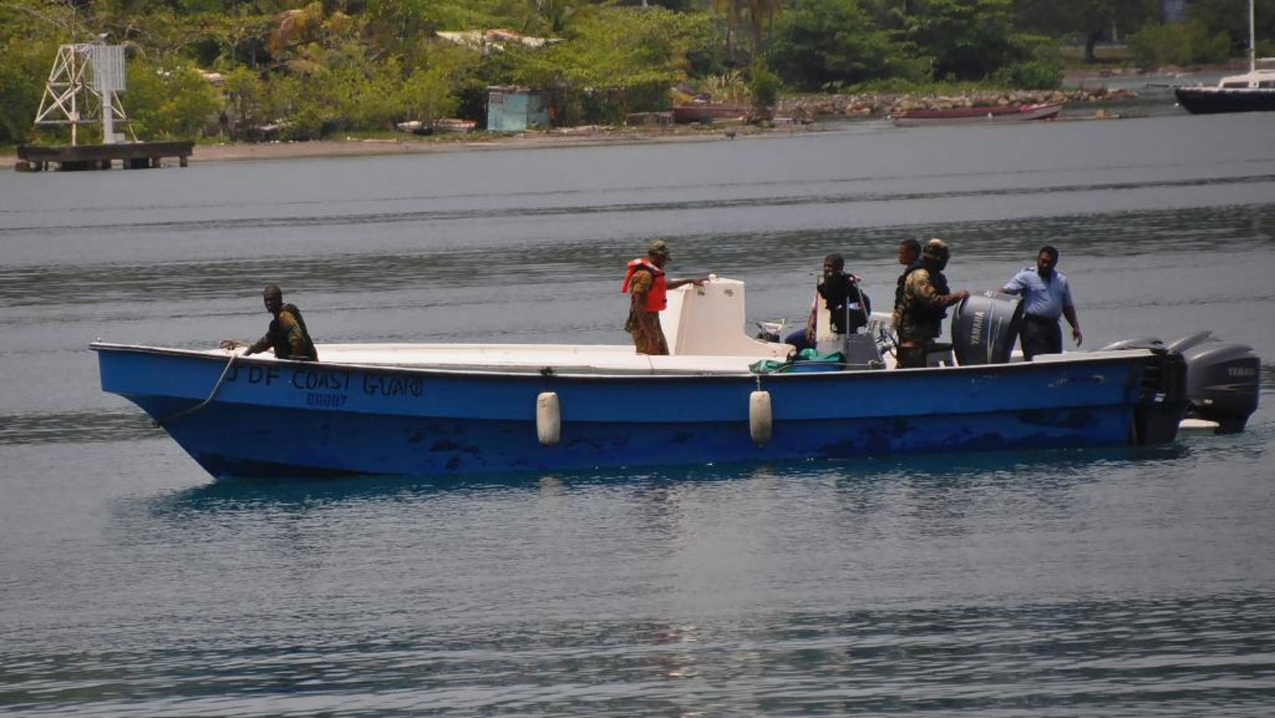 Jamaican Defence Force members return to Port Antonio Marina in Portland, Jamaica, Saturday, Sept. 6, 2014, after a fruitless search for a plane that crashed into the ocean a day earlier. Rescue crews searching off Jamaica's coast on Saturday said they could no longer see debris spotted earlier, stymieing efforts to solve the mystery surrounding a small plane carrying a prominent upstate New York couple that went on a ghostly 1,700-mile journey after the pilot was apparently incapacitated. Jamaican officials said that possible wreckage from the single-engine turboprop Socata TBM700 was sighted Friday evening by a military aircraft flying off the island's northeast coast, drifting roughly 24 miles off the coastal town of Port Antonio. (AP Photo/Everard Owen)