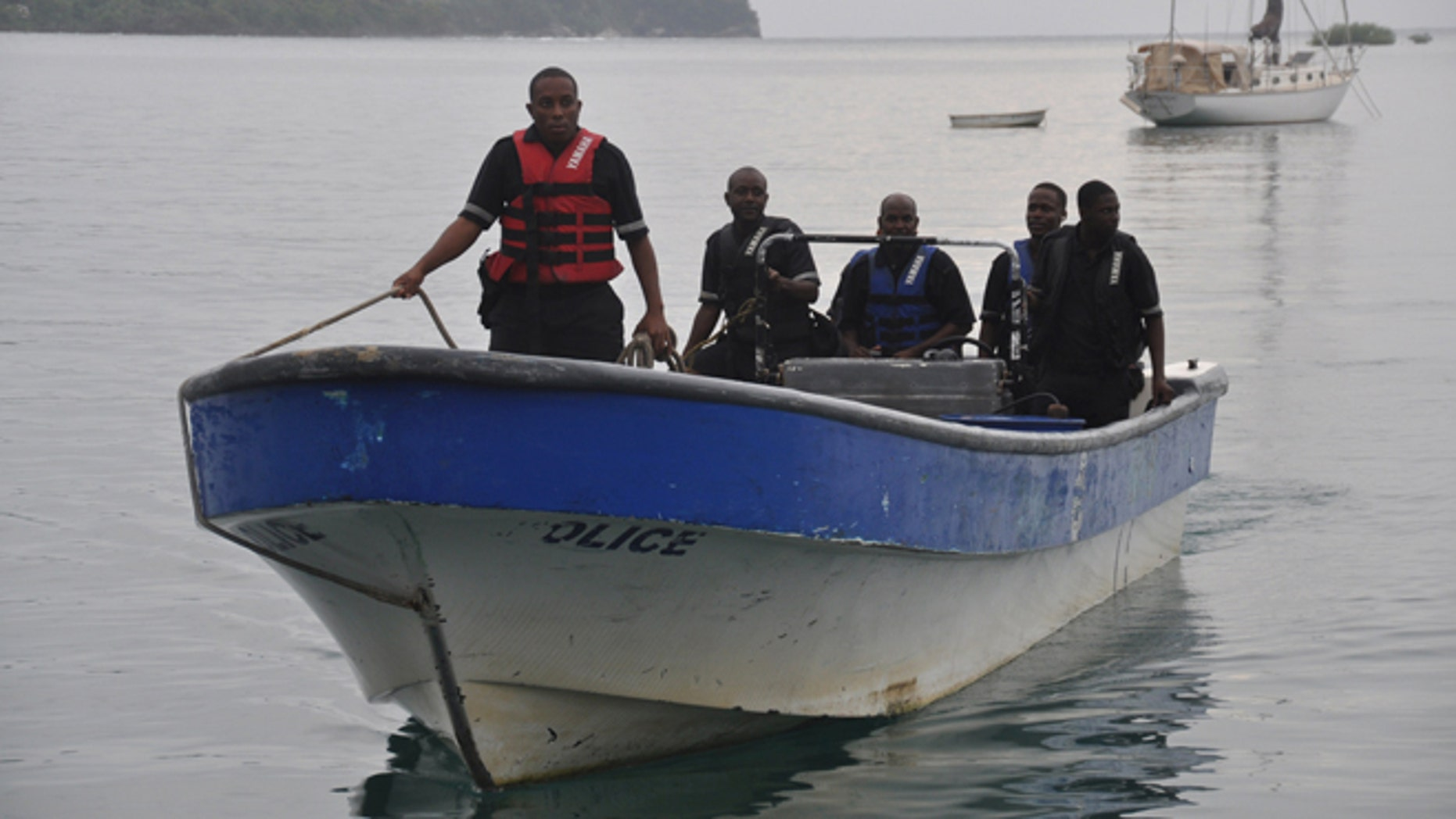 Jamaican Marine Police return to the Port Antonio Marina after a fruitless search for a plane that crashed into the ocean near Port Antonio, Jamaica, Friday, Sept. 5, 2014. A small plane flew down the Atlantic Coast and beyond Friday before finally crashing in the waters off Jamaica. The fate of the two or more people aboard was not immediately known. Maj. Basil Jarrett of the Jamaican Defense Force said the plane went down northeast of the coastal town of Port Antonio and the military dispatched two aircraft and a dive team. (AP Photo/Everard Owen)