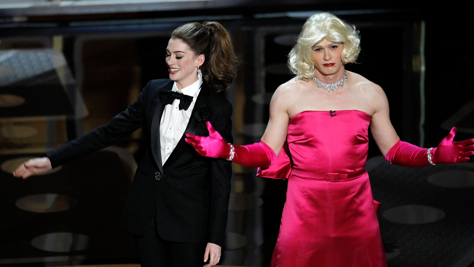 James Franco dresses up as Marilyn Monroe while hosting the 2011 Academy Awards with Anne Hathaway.