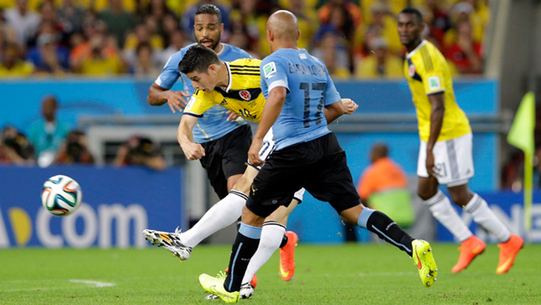 James Rodriguez shoots to score his team's first goal during the World Cup, on June 28, 2014.