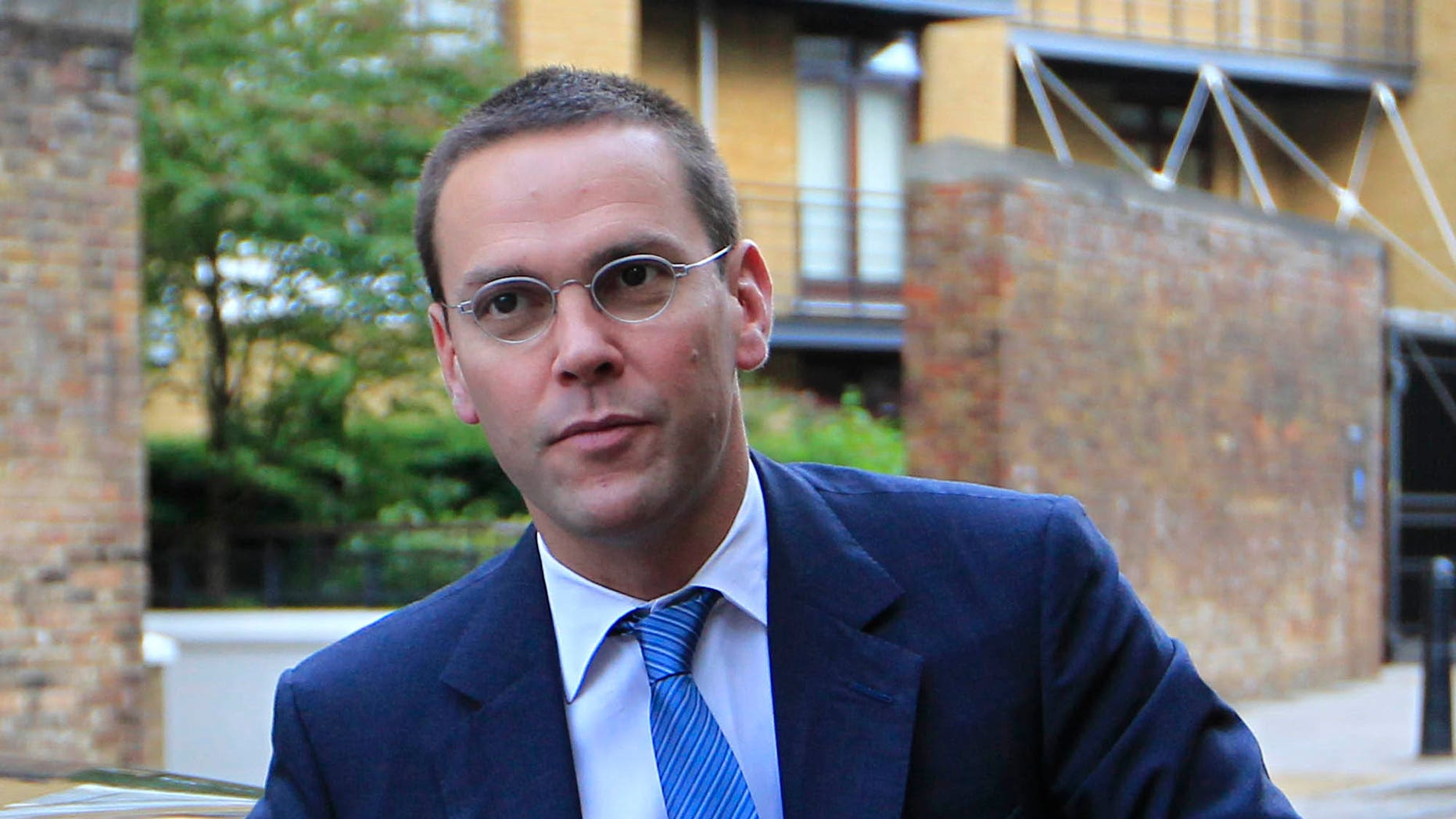 July 19: Chief executive of News Corporation Europe and Asia, James Murdoch, arrives at the News International headquarters in London.