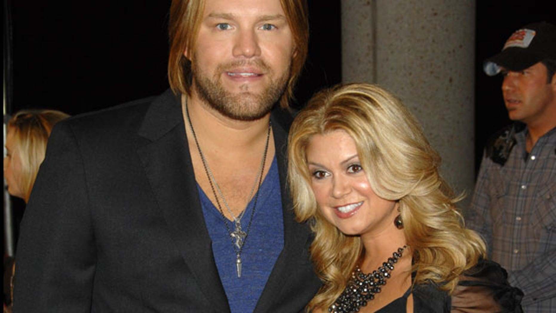 In this Nov. 10, 2009 file photo, recording artist James Otto and his wife Amy attend the 57th Annual BMI Country Awards in Nashville, Tenn.