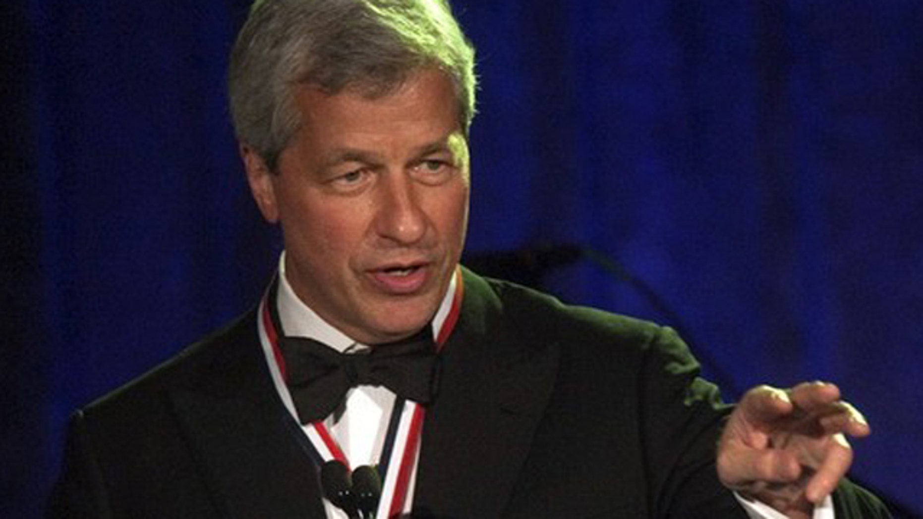 May 24, 2012: Jamie Dimon, chairman and chief executive of JP Morgan Chase and Co, speaks during the Intrepid Sea, Air & Space Museum's Annual Salute to Freedom dinner in New York.