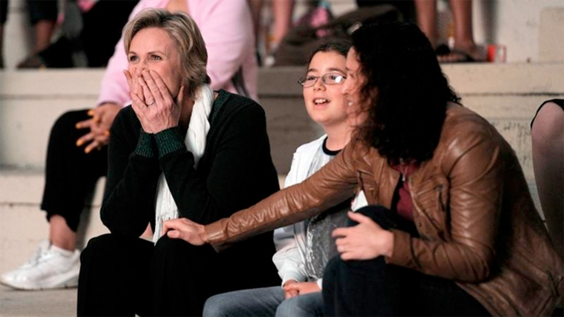 Jane Lynch with wife Dr. Lara Embry and Chase, one of her two step-daughters.