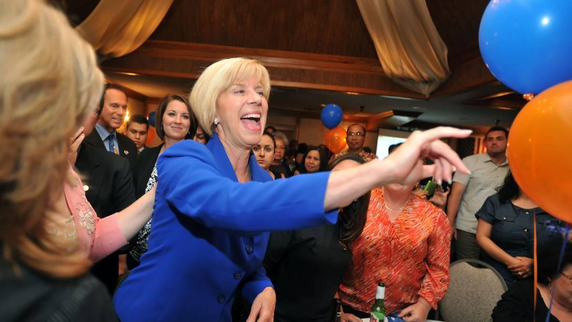 Los Angeles City councilwoman Janice Hahn, running for Congressional District 36th, makes her way through the crowd of supporters Tuesday night July 12, 2011 at her election party. (AP Photo/Sean Hiller - Daily Breeze)