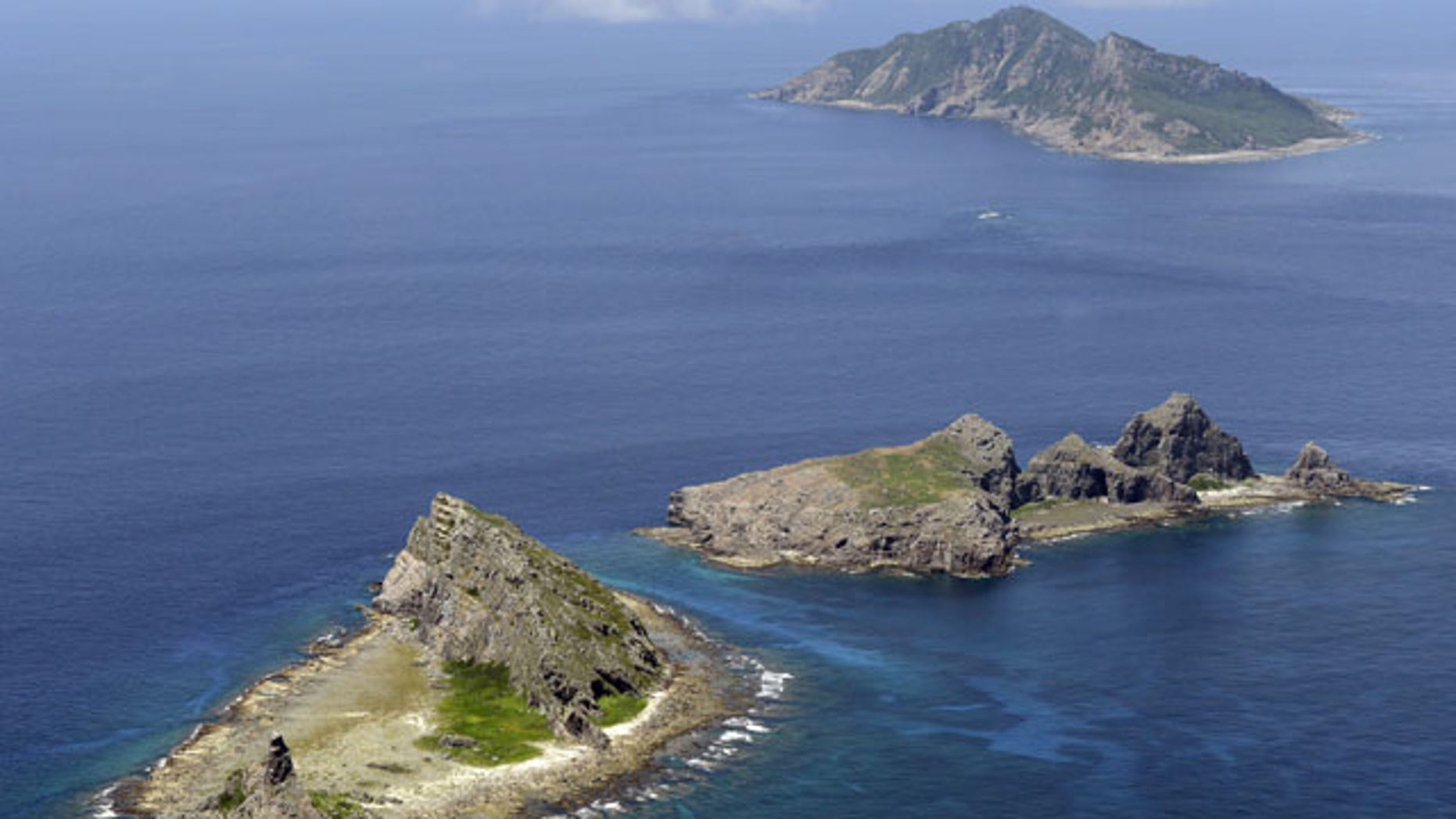 In this Sept. 2012 photo, the tiny islands in the East China Sea, called Senkaku in Japanese and Diaoyu in Chinese are seen. (AP Photo/Kyodo News)