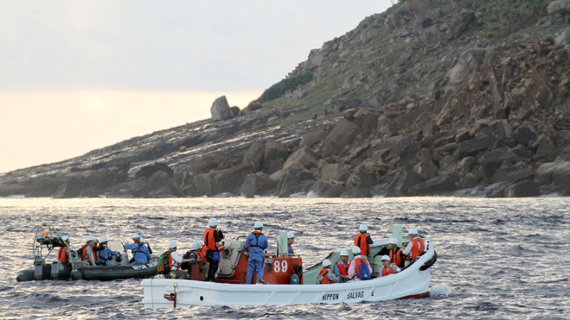 Sept. 2, 2012: Tokyo city officials and experts survey Uotsuri Island, one of the islands of Senkaku in Japanese and Diaoyu in Chinese, in the East China Sea.