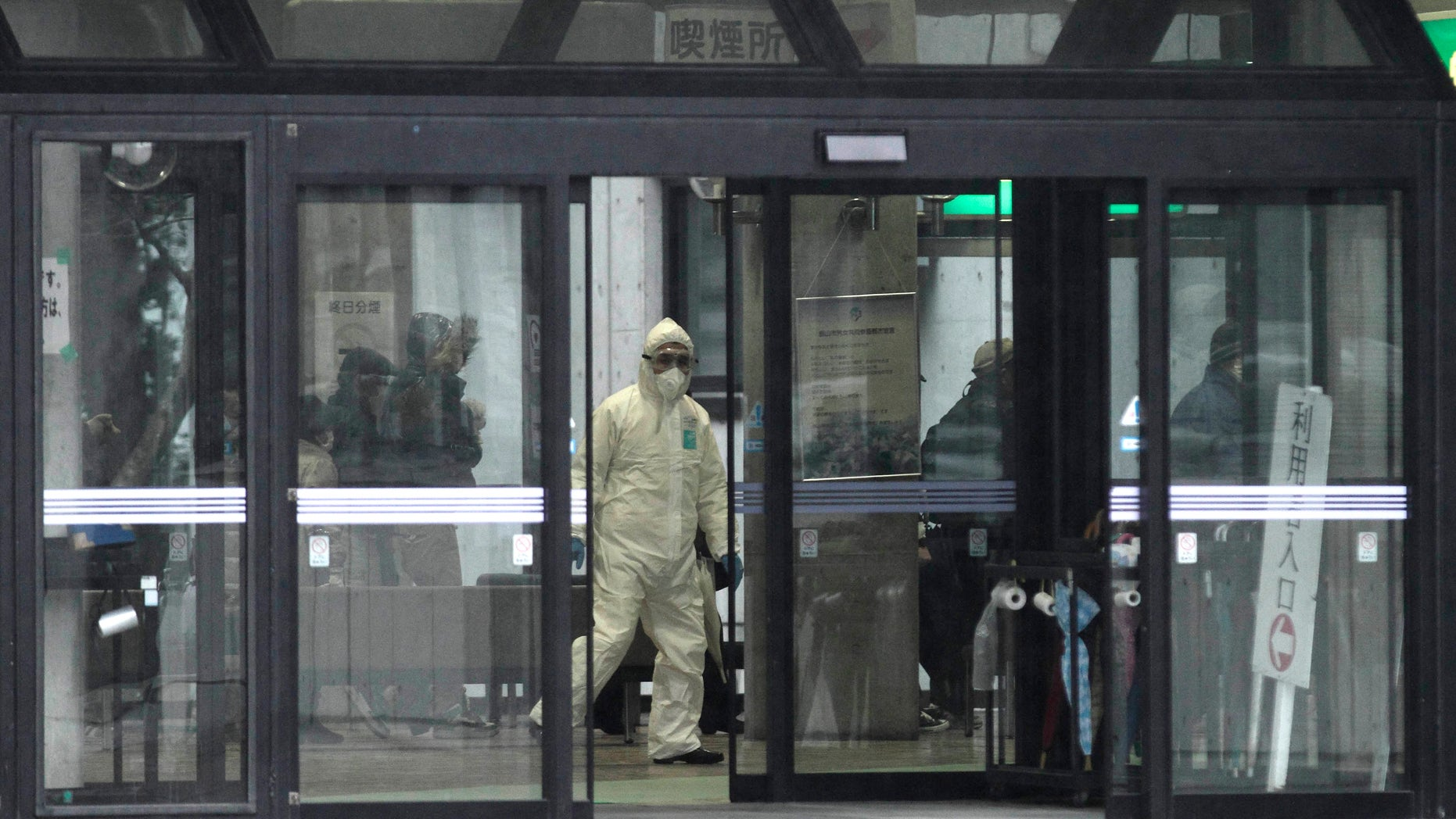 March 15: Officials wearing clothing to protect against radiation work in a center to scan residents who have been within 20 kilometers of the Fukushima Dai-ichi nuclear plant damaged by the March 11 earthquake.A U.S. nuclear industry official says there is evidence that the primary containment structure at one of the stricken Japanese reactors has been breached, raising the risk of further release of radioactive material.