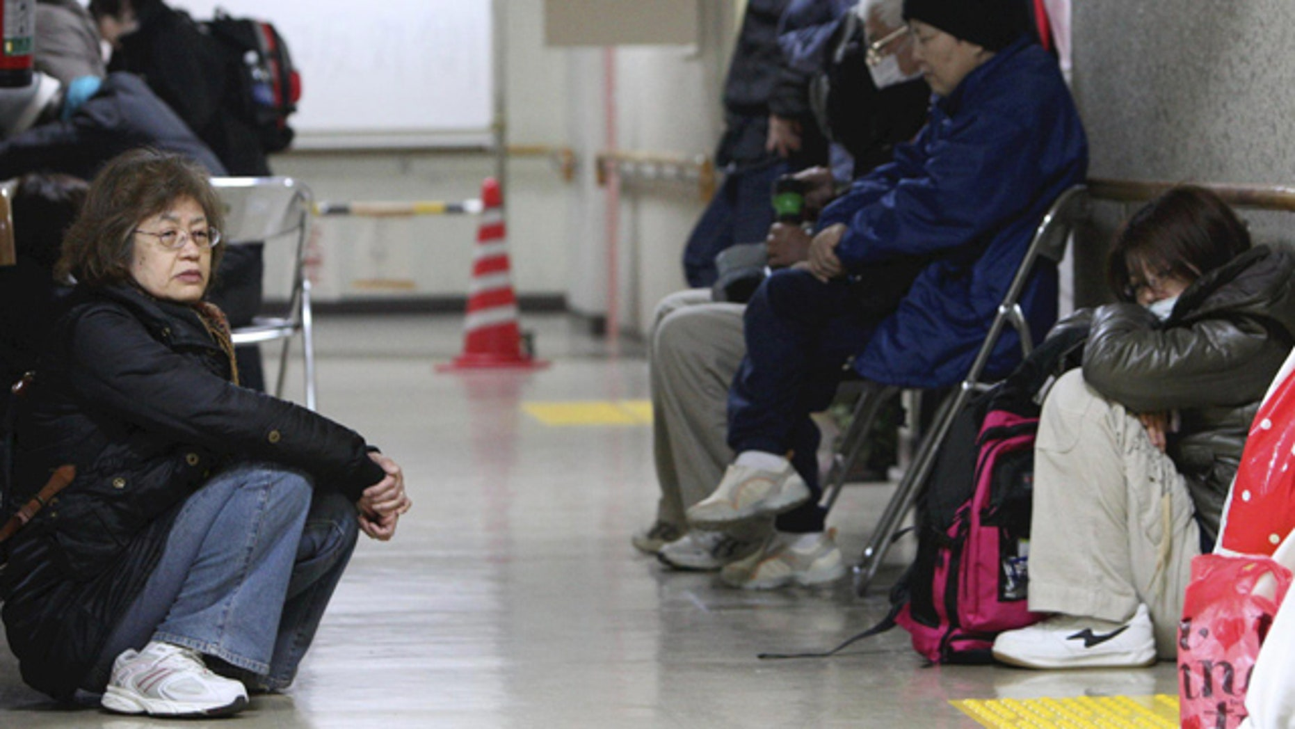 April 8, 2011: Evacuees with their belongings gather at the lobby of their shelter in Sendai, Miyagi Prefecture, northeastern Japan.