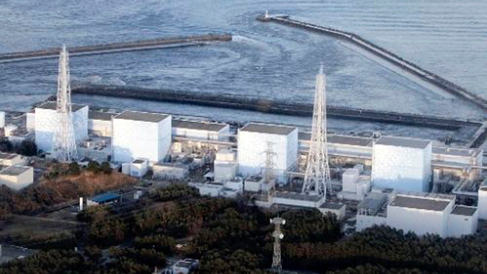 March 11: Fukushima Daiichi power plant's Unit 1 is seen in Okumamachi, Fukushima prefecture, Japan. The nuclear power plant affected by a massive earthquake is facing a possible meltdown, an official with Japan's nuclear safety commission said Saturday. (AP/The Yomiuri Shimbun)