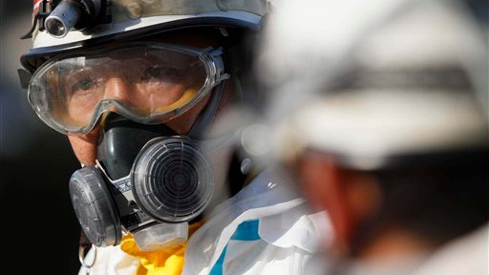 March 13: An official wears protective clothing while waiting to scan people for radiation an emergency center in Koriyama, northeastern Japan, two days after a giant quake and tsunami struck the country's northeastern coast. (AP)
