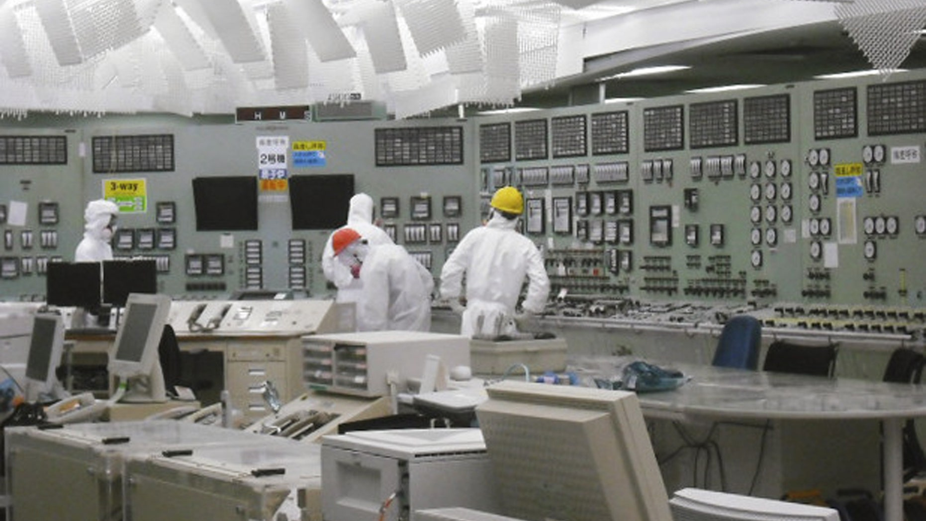 March 26: In this photo released by Tokyo Electric Power Co. via Kyodo News, lighting becomes available in the control room of Unit 2 reactor at the stricken Fukushima Dai-ichi nuclear power plant in Okumamachi, Fukushima prefecture, Japan. (AP/TEPCO)